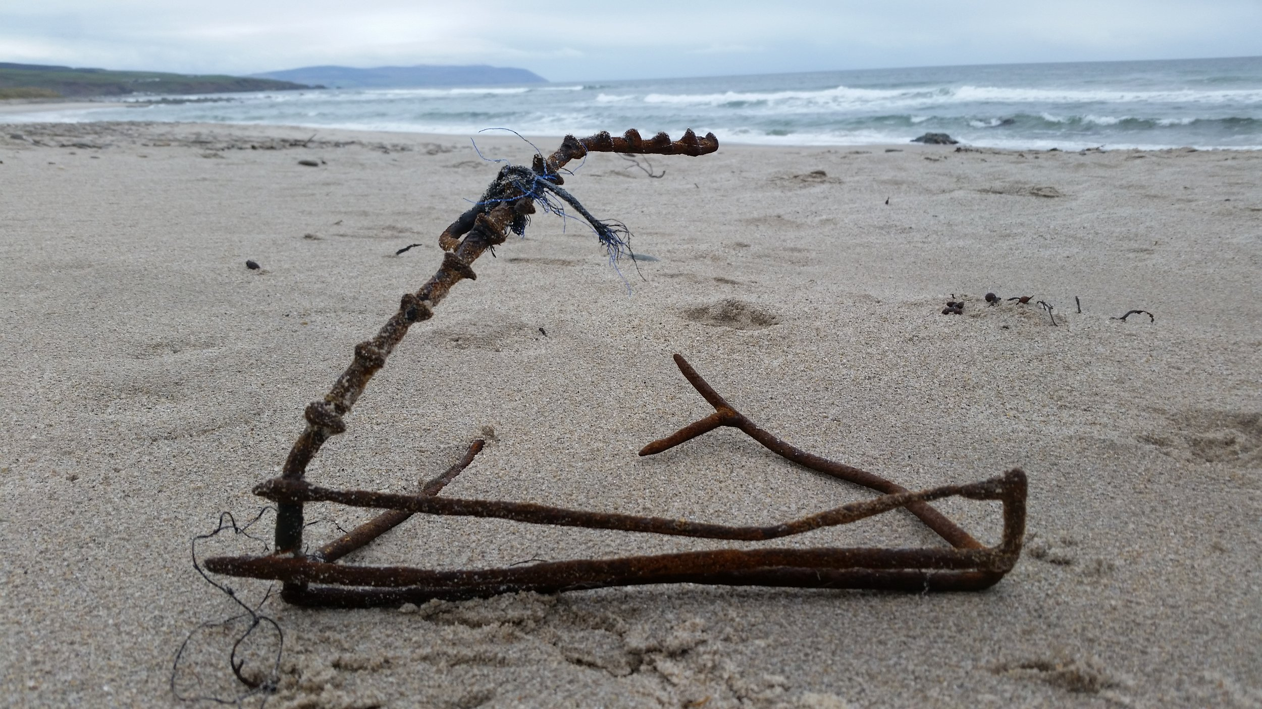 This nasty piece of kit we found half buried, it looks more like a bear trap than a lobster trap!
