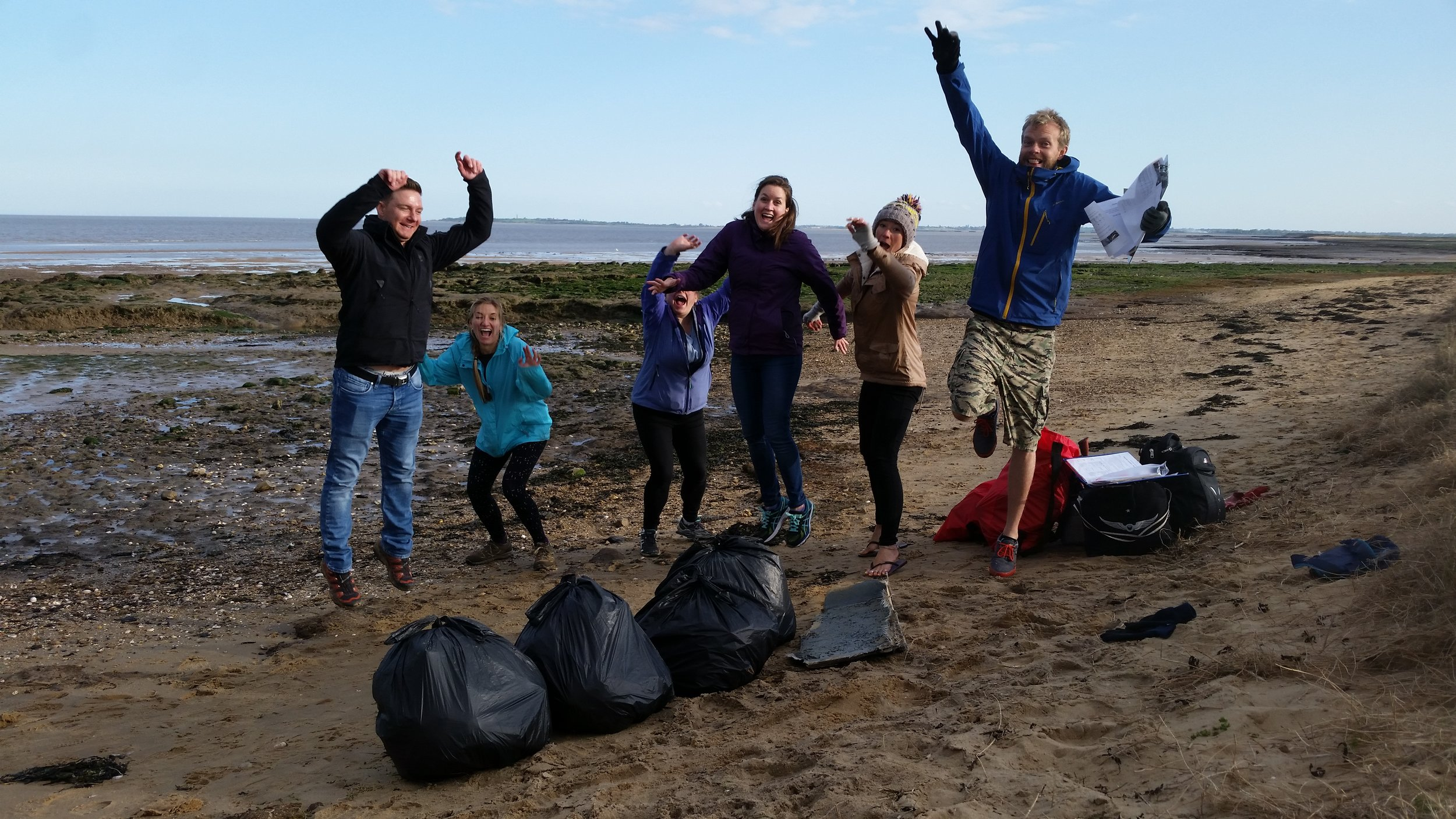 Jumping for joy on our last beach clean of Phase I at Dovercourt Beach, Essex.