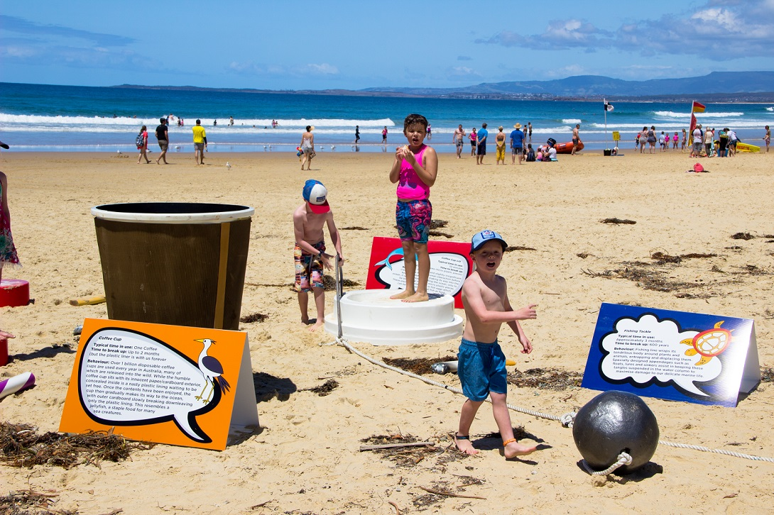 Learning at play, kids getting involved in the beach clean.