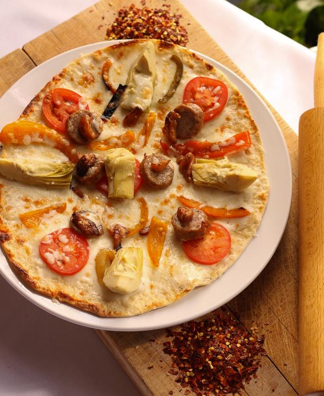 Aurora Pizza   Italian sausage, mozzarella, fontina, artichokes, roasted garlic, peppers, onions, tomatoes, Marsala parmesan cream sauce