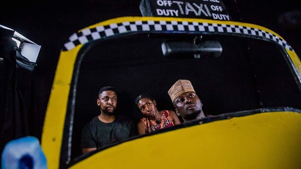 """The music video I directed for @ayoinmotion 's """"Ifemelu"""" is finally out. This was a fun opportunity to step out of the doc world, and do something conceptual. We recreated New York City thanks to local Ibadan carpenters and the beautiful taxi cut outs by @moonvisuals. @emmanetim flew all the way to Ibadan from Accra, and my gorgeous sister @whoistonye agreed to be my muse. We were inspired by @chimamanda_adichie 's Americanah and took the opportunity to speak about the cost of immigration and what we leave behind when we chose to pursue the western dream. The link is in my bio. Thank you for watching and sharing! • • #womeninfilmandtv #femaledirectors #americanah #storytellers #nigerianfilm #newnollywood"""