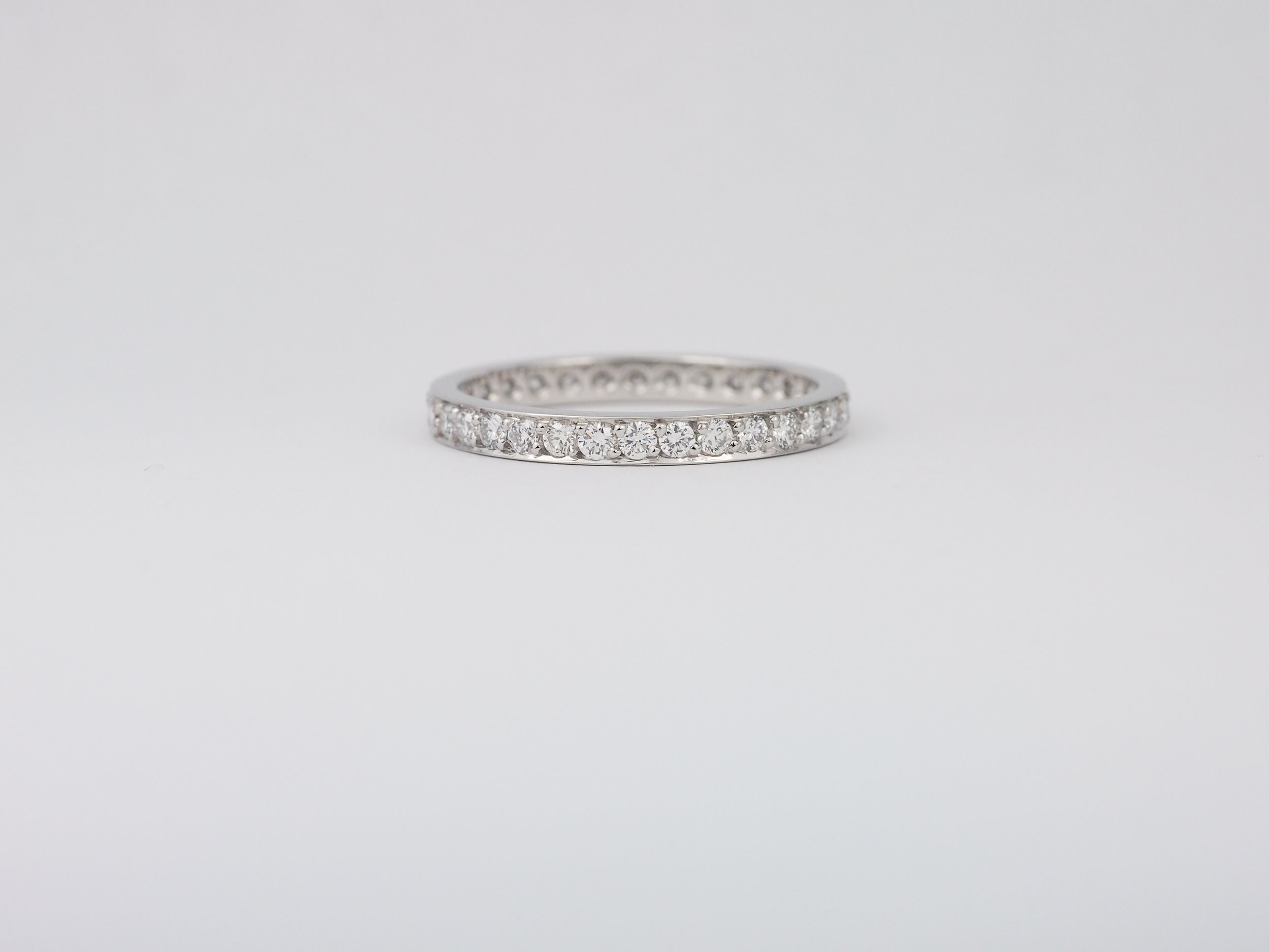 Pavé set diamond wedding band in platinum