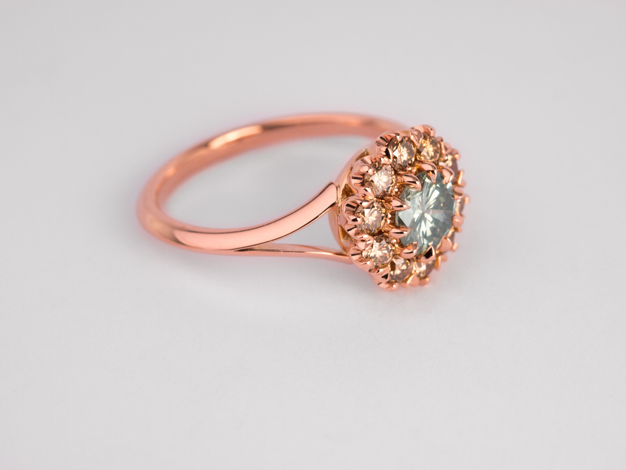 Champagne diamond cluster engagement ring in rose gold.