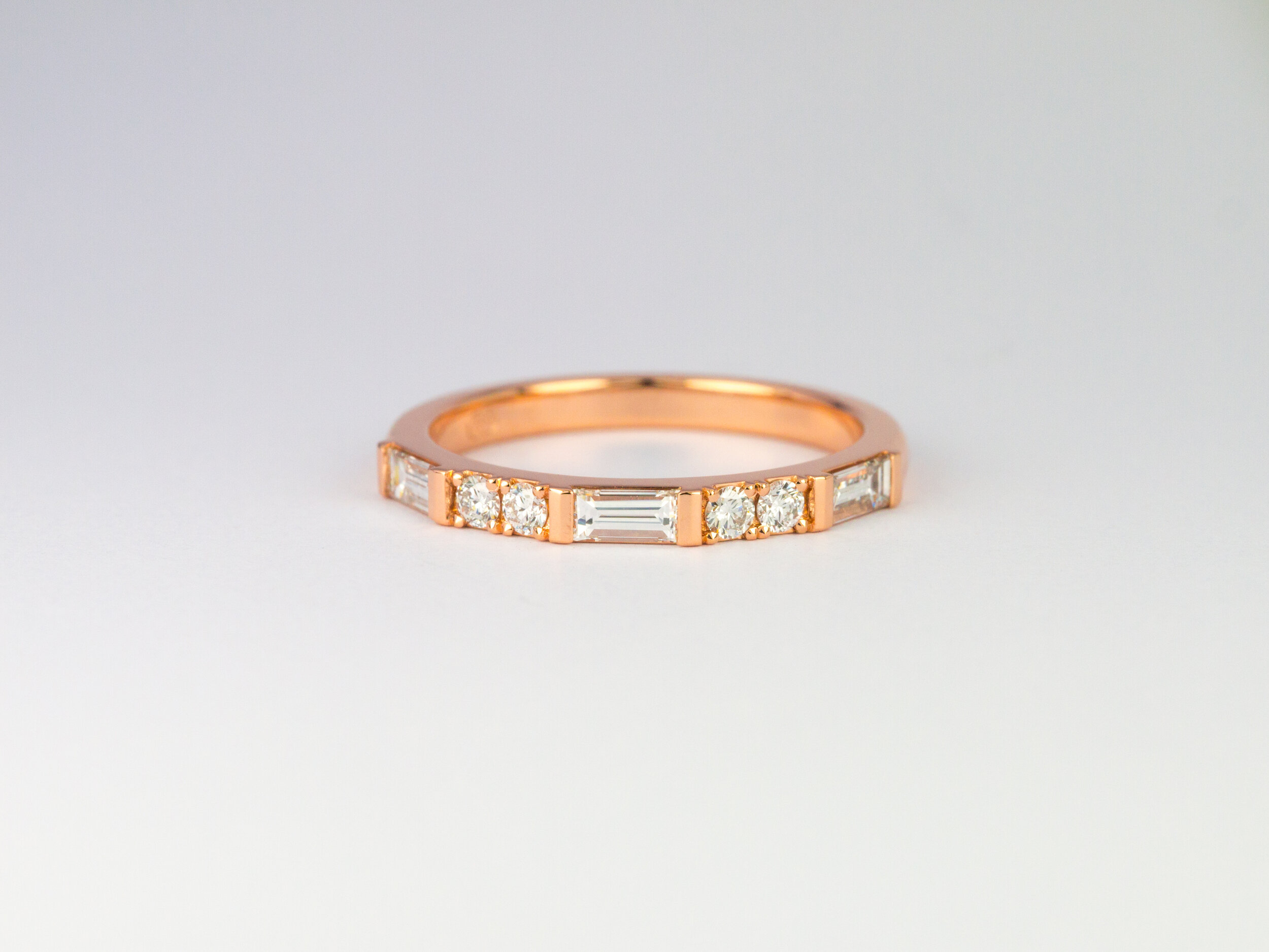Rose gold baguette diamond and round brilliant cut diamond ring