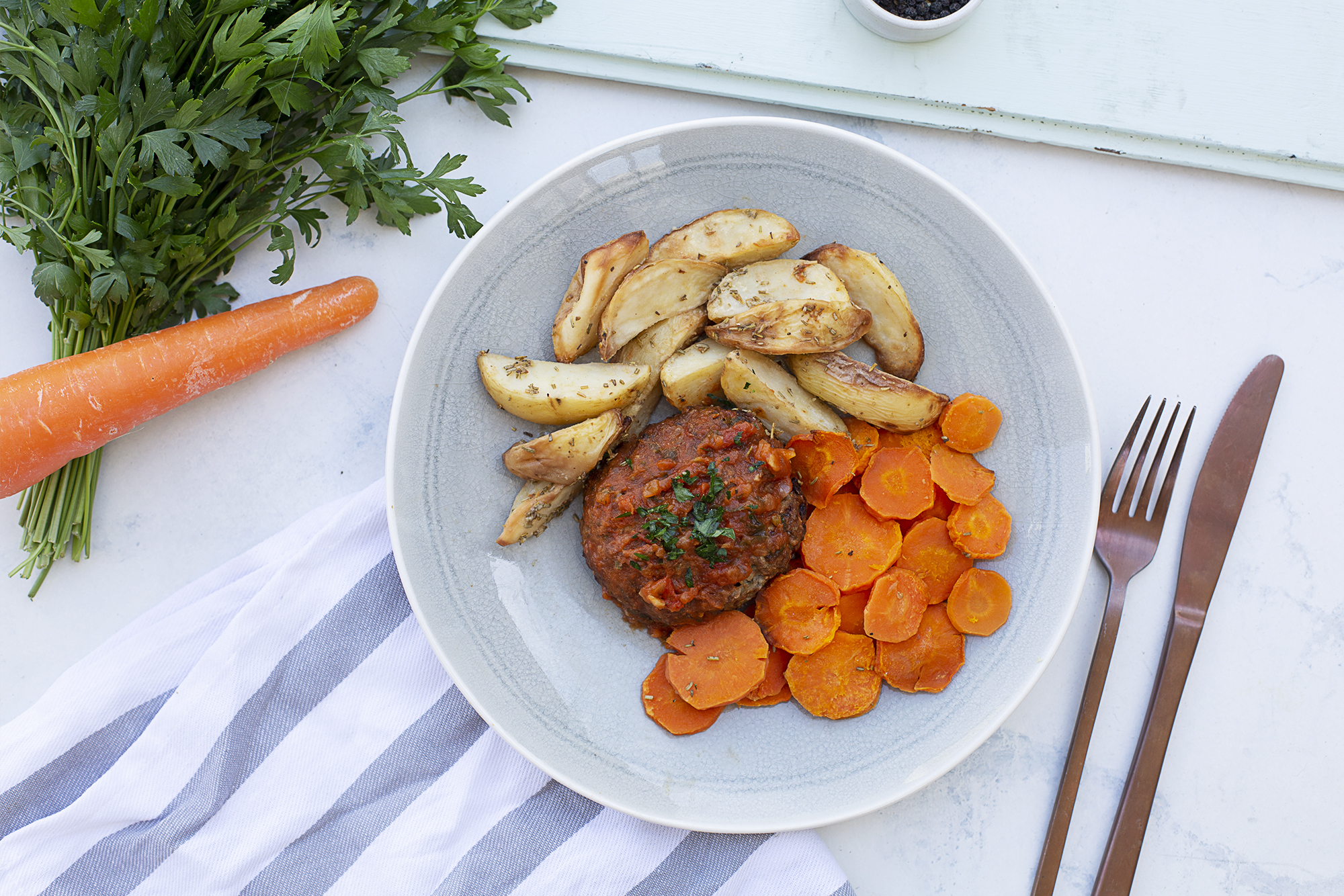 195. Naked burger served with herb roasted potato wedges and honey roasted carrots