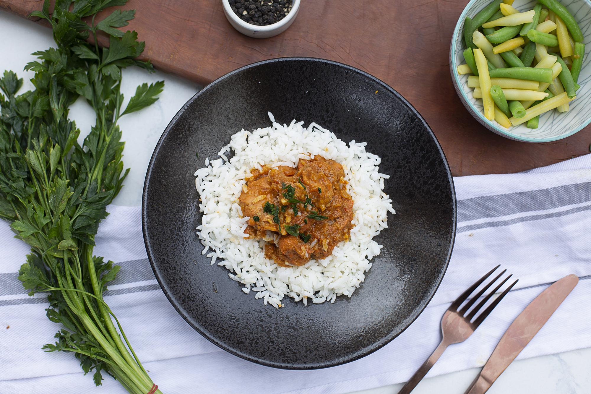 145. Chicken Tikka Masala served with rice and an Aussie bean mix