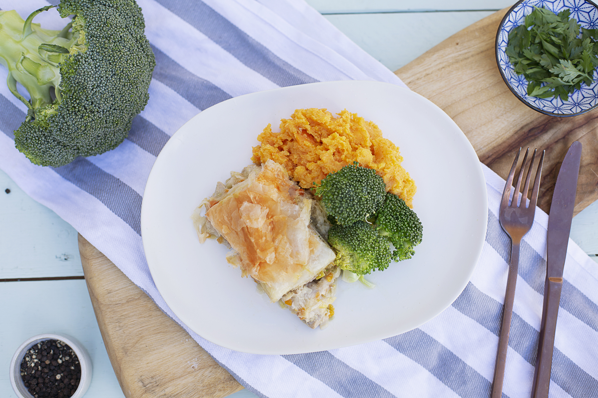 1005. Chicken and Leek Pie served with broccoli and a roast pumpkin and sweet potato smash