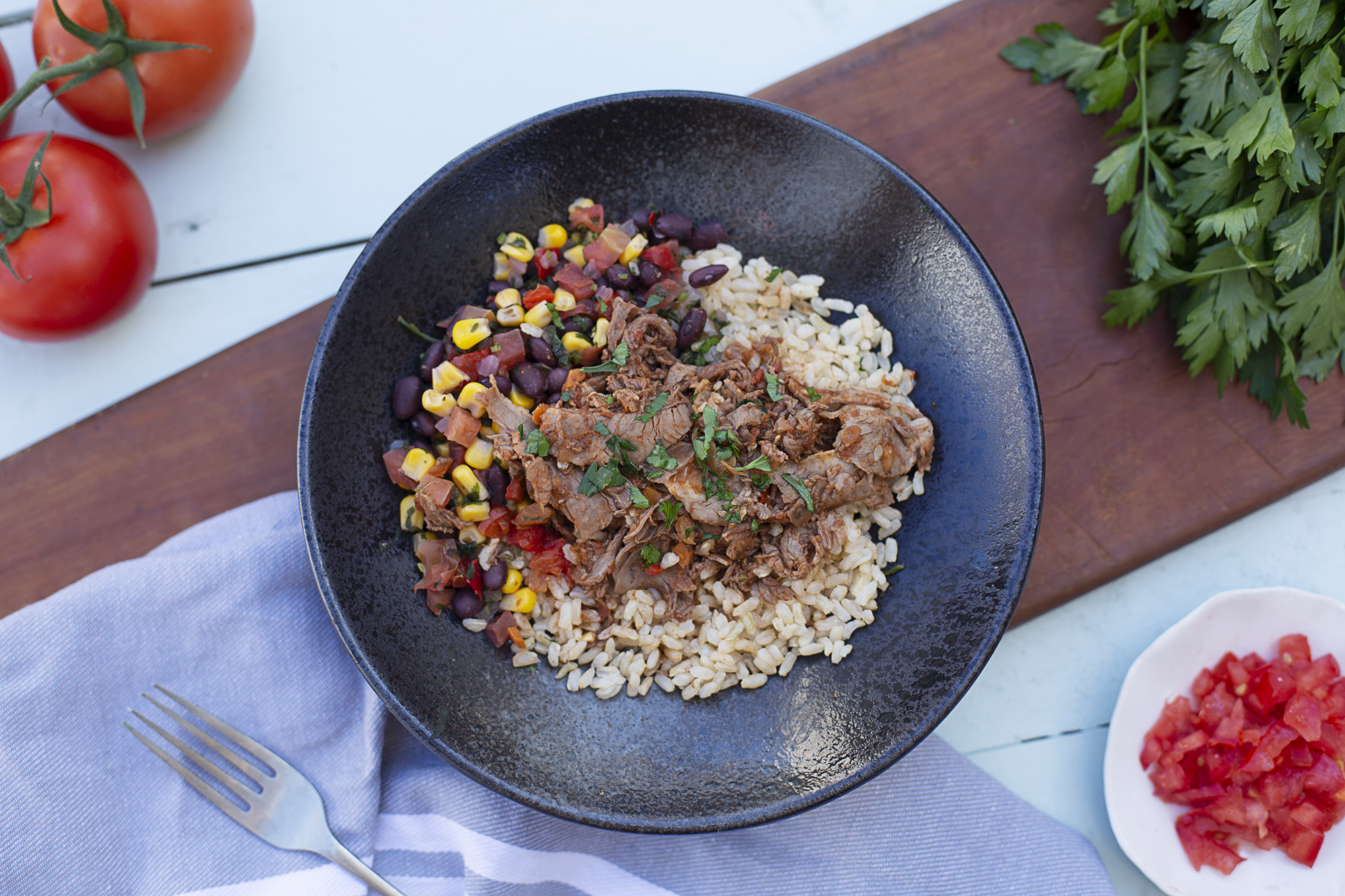 1002. Beef Burrito Bowl served with coriander, corn, tomato, bean salsa and brown rice