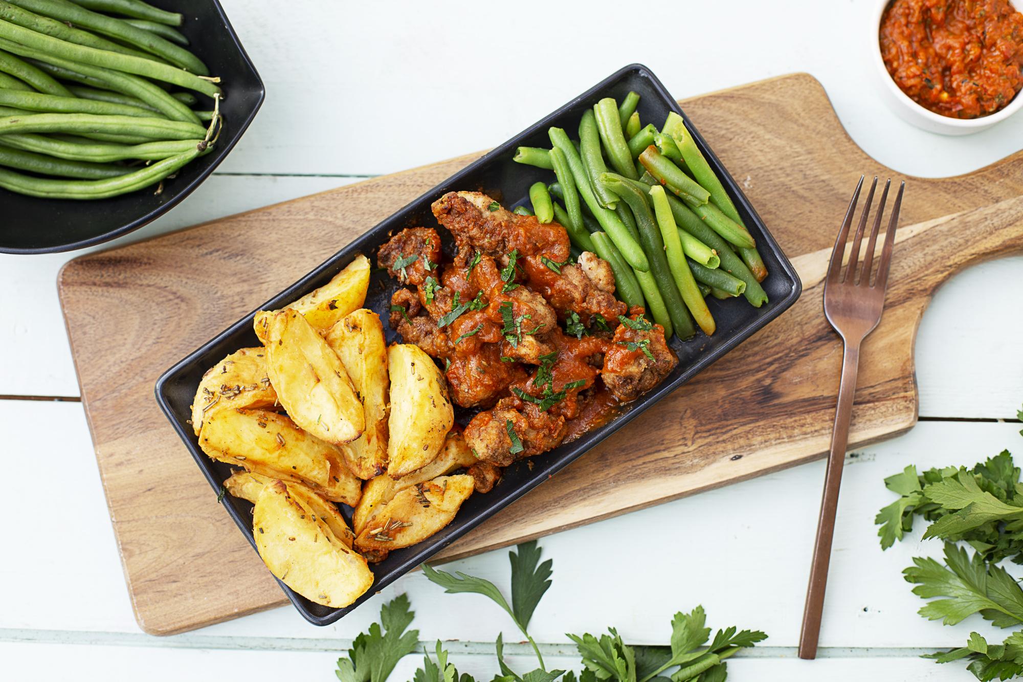 1014. Buffalo Chicken Poppers w buffalo sauce, potato wedges & beans