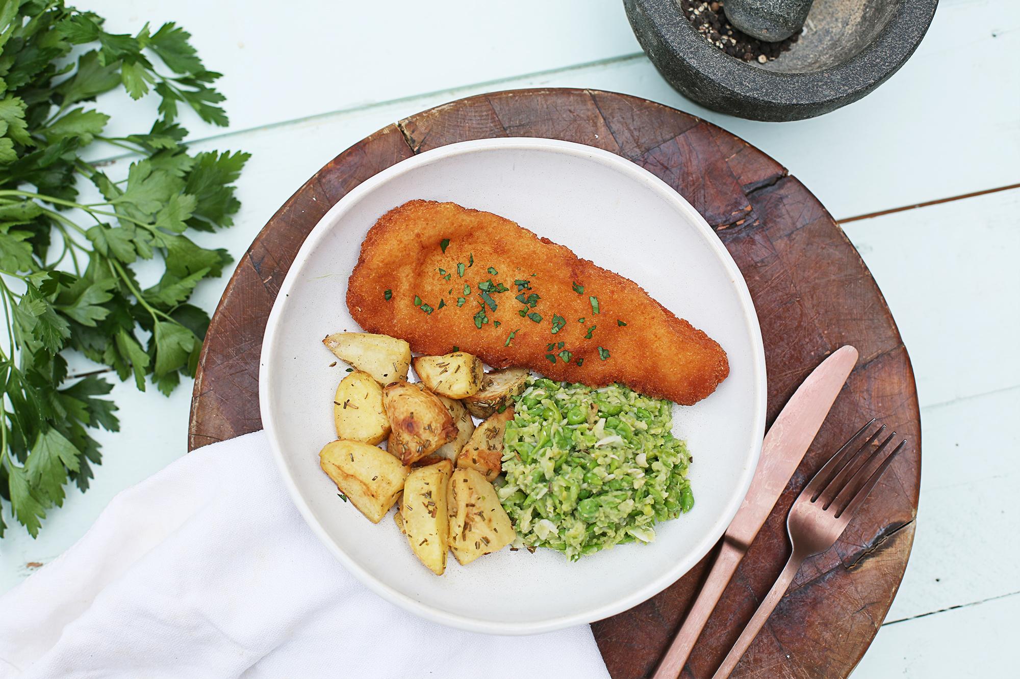 1009. Fish n' Chips w potato wedges & mushy peas