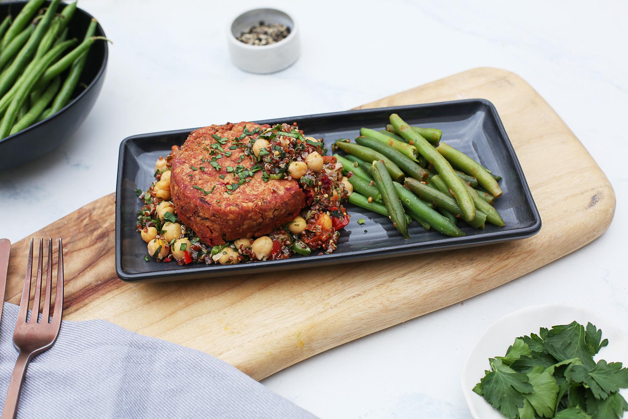1010. Naked Beet & Chickpea Burgerw quinoa lentil salad & beans