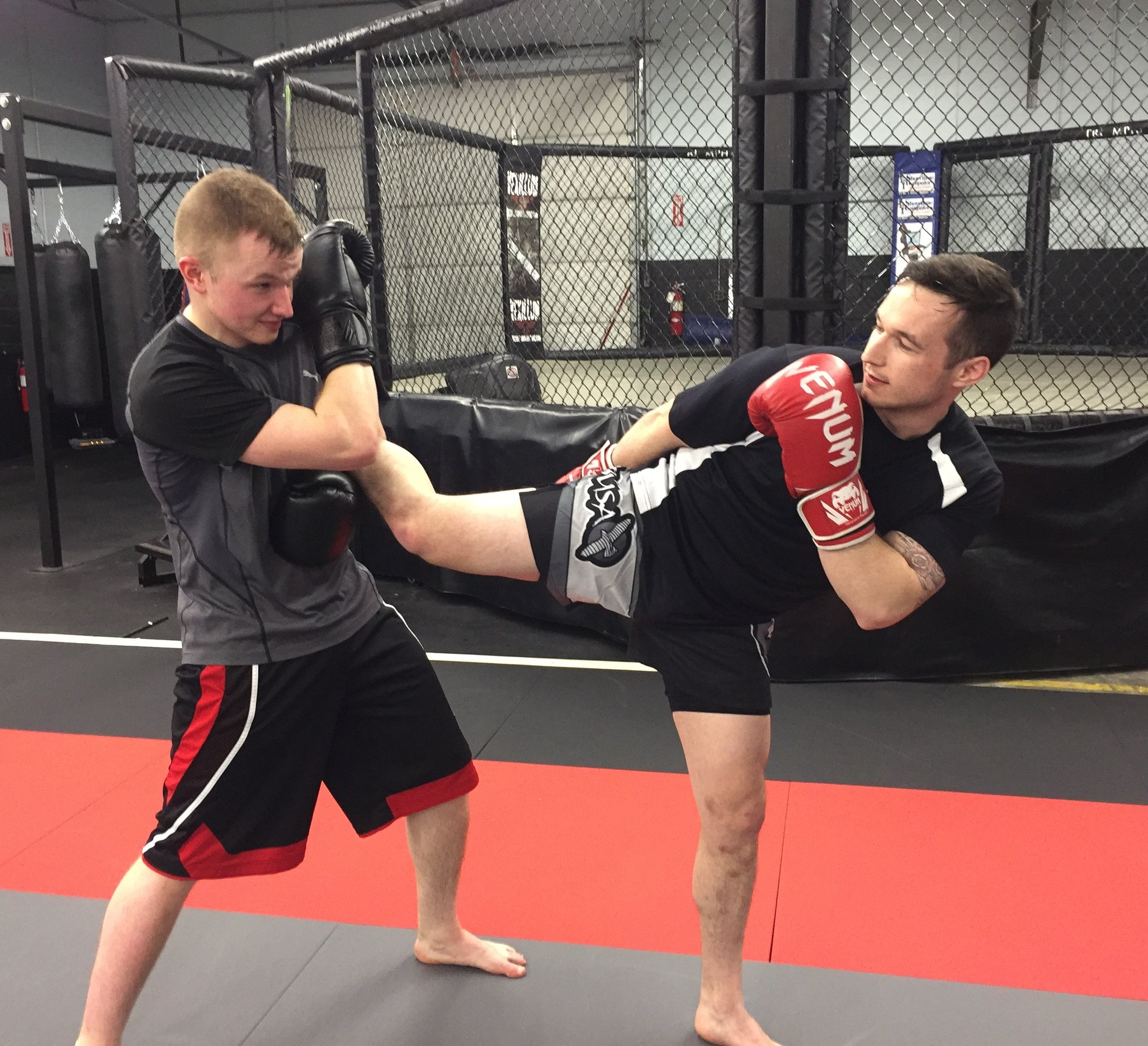 Students drill in Muay Thai class.