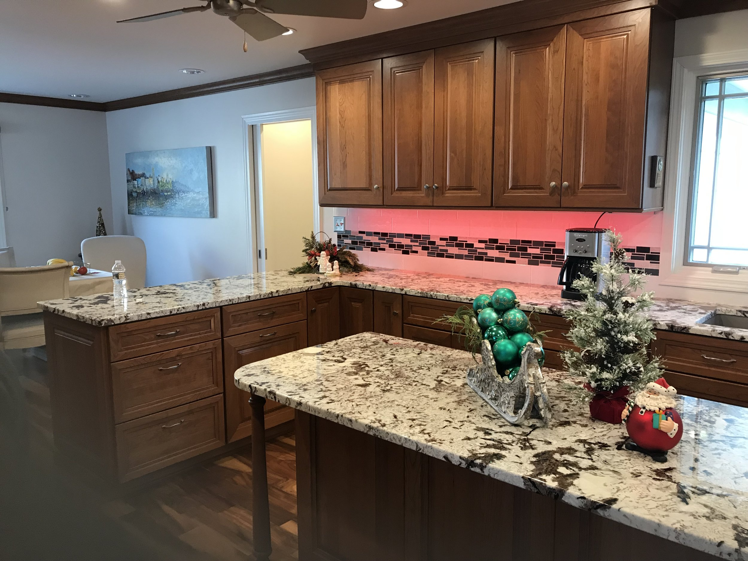 The need for a first floor master suite addition meant another kitchen remodel three years later!  Opening up the kitchen to the dining room gave us room to add an island for more seating and prep space.