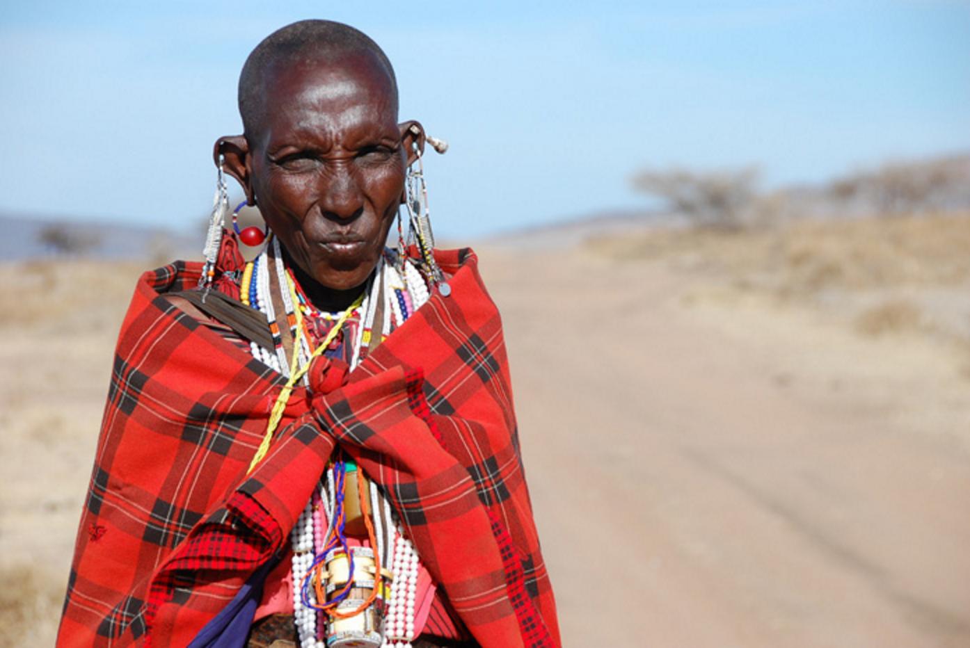 A Masai woman crosses the vast Loliondo plains.