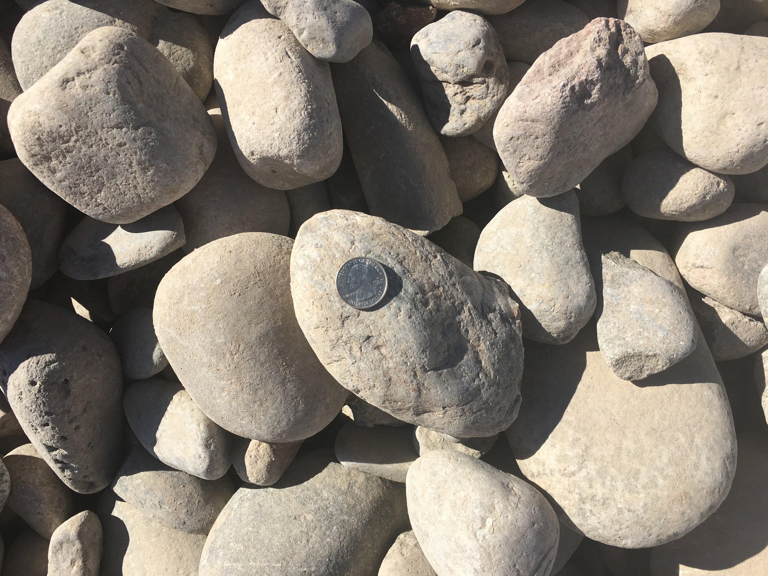 "2-4"" Round  Small to medium sized cobble rock used for erosion protection, sewer leach fields and landscaping"