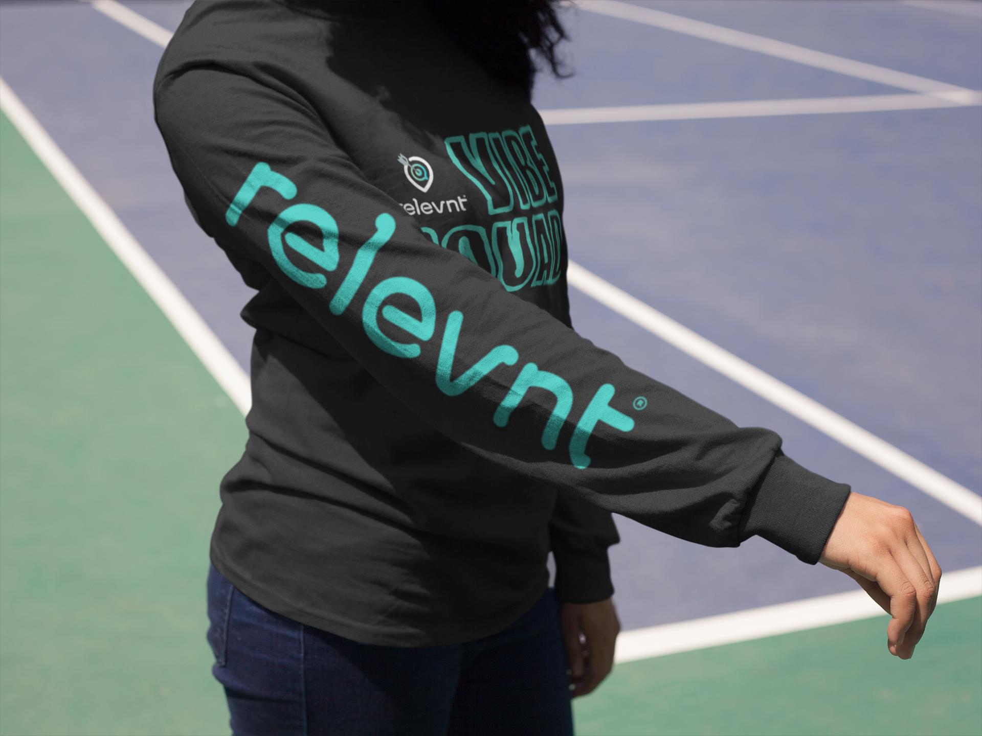 girl-showing-her-right-arm-while-wearing-a-long-sleeve-tshirt-mockup-at-a-tennis-court-a15980.png
