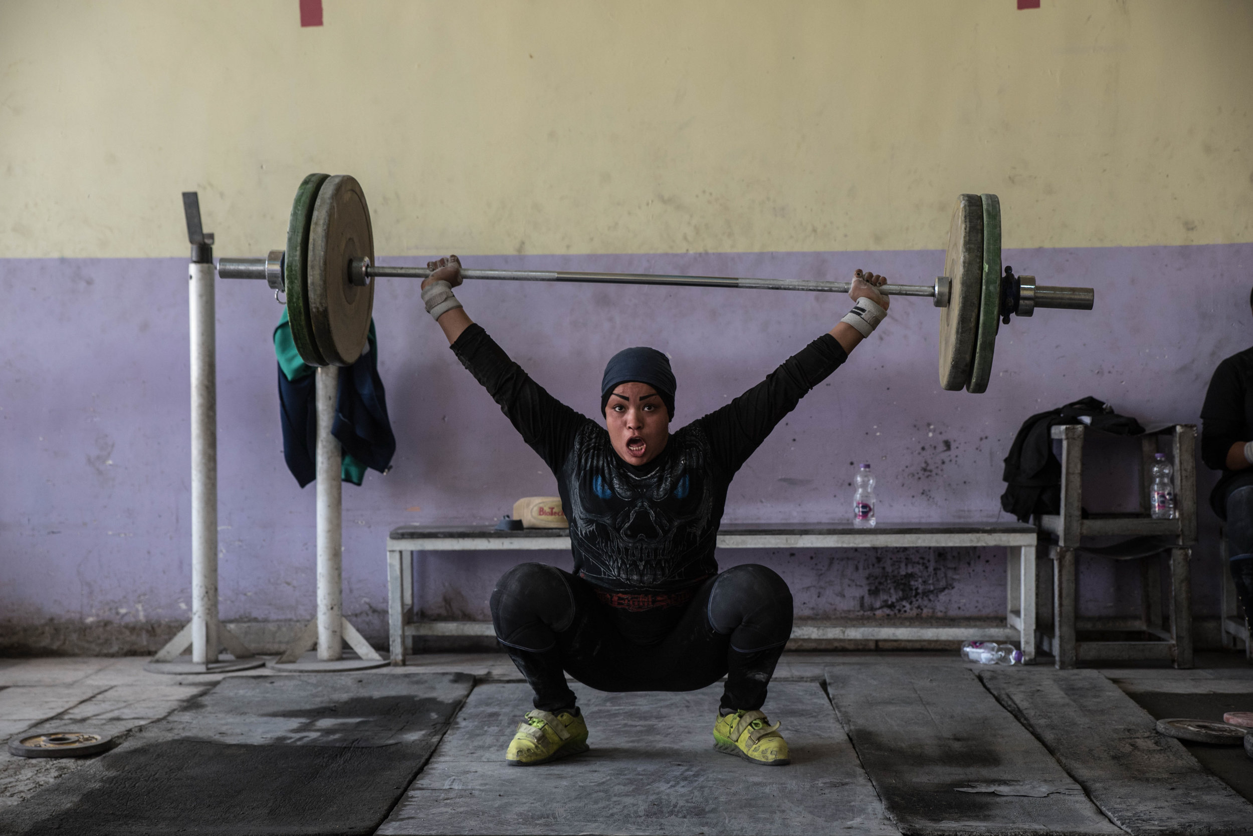 "EMILIENNE MALFATTO |  www.emalfatto.com  |  @emiliennemalfatto   Huda Salem shouts ""Oh Hussein"" as she lifts 60 kgs in a sports hall in Sadr City, Baghdad. Before lifting the weights, she invokes the name of Imam Hussein or Imam Ali, two main figures of Shiite Islam. ""It is like a blessing,"" she explains.   [ The Washington Post ]"