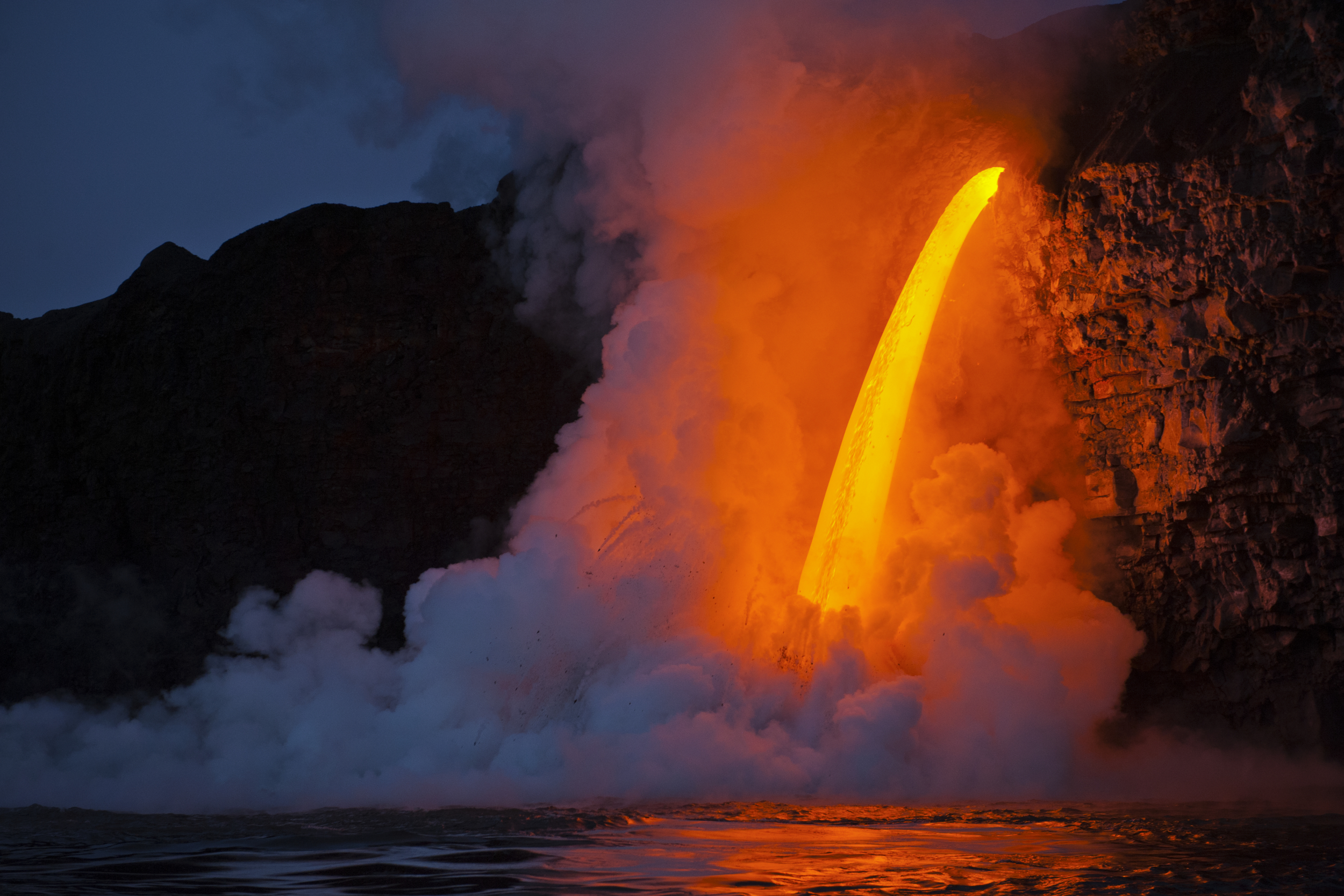 ELYSE BUTLER |  www.elysebutler.com  |  @oceanelyse   A massive lava stream from Kilauea Volcano flows into the ocean from a lava tube at the Kamokuna ocean entry on the southeast side of the Big Island at sunrise.   [ Smithsonian Magazine ]