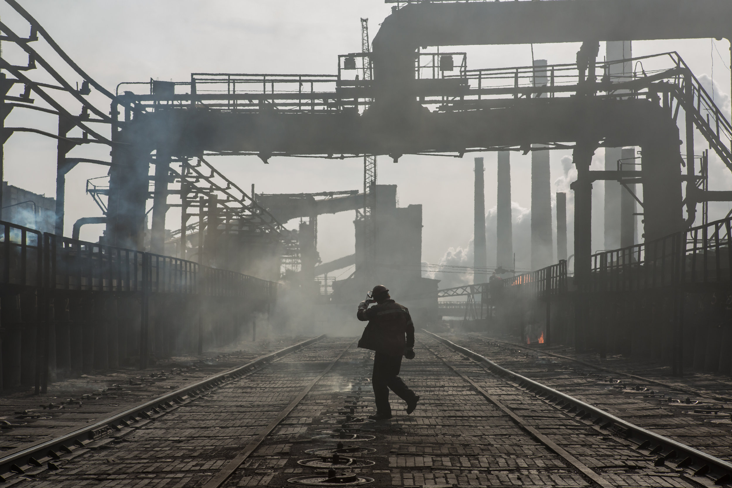 OKSANA PARAFENIUK |  www.oksanaparafeniuk.com  |  @oksana_par   A worker walks on top of a furnace at the Avdiivka Coke and Chemical Plant in Avdiivka, Donetsk region, Ukraine on March 13, 2017. The factory, the main supplier of the Ukrainian steel industry, is operating at a reduced capacity due to a shortage of coal from non-government controlled eastern Ukraine caused by a blockade.  [ U.S. News ]