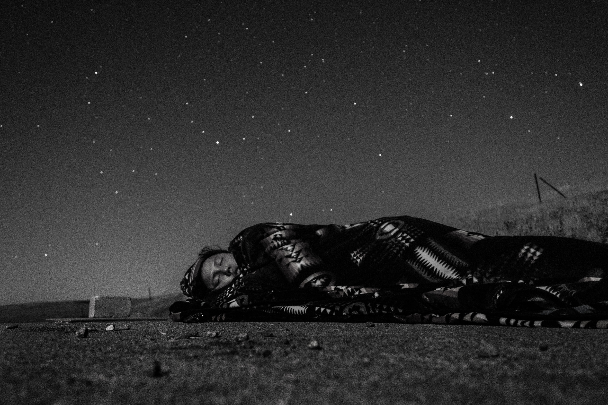 EMILY SCHIFFER |  www.emilyschiffer.com  |  @emilyschiffer   Jordan, asleep under the stars on our storm shelter/darkroom roof on the Cheyenne River Reservation, after printing in the darkroom until 3 a.m.   [ The Washington Post ]