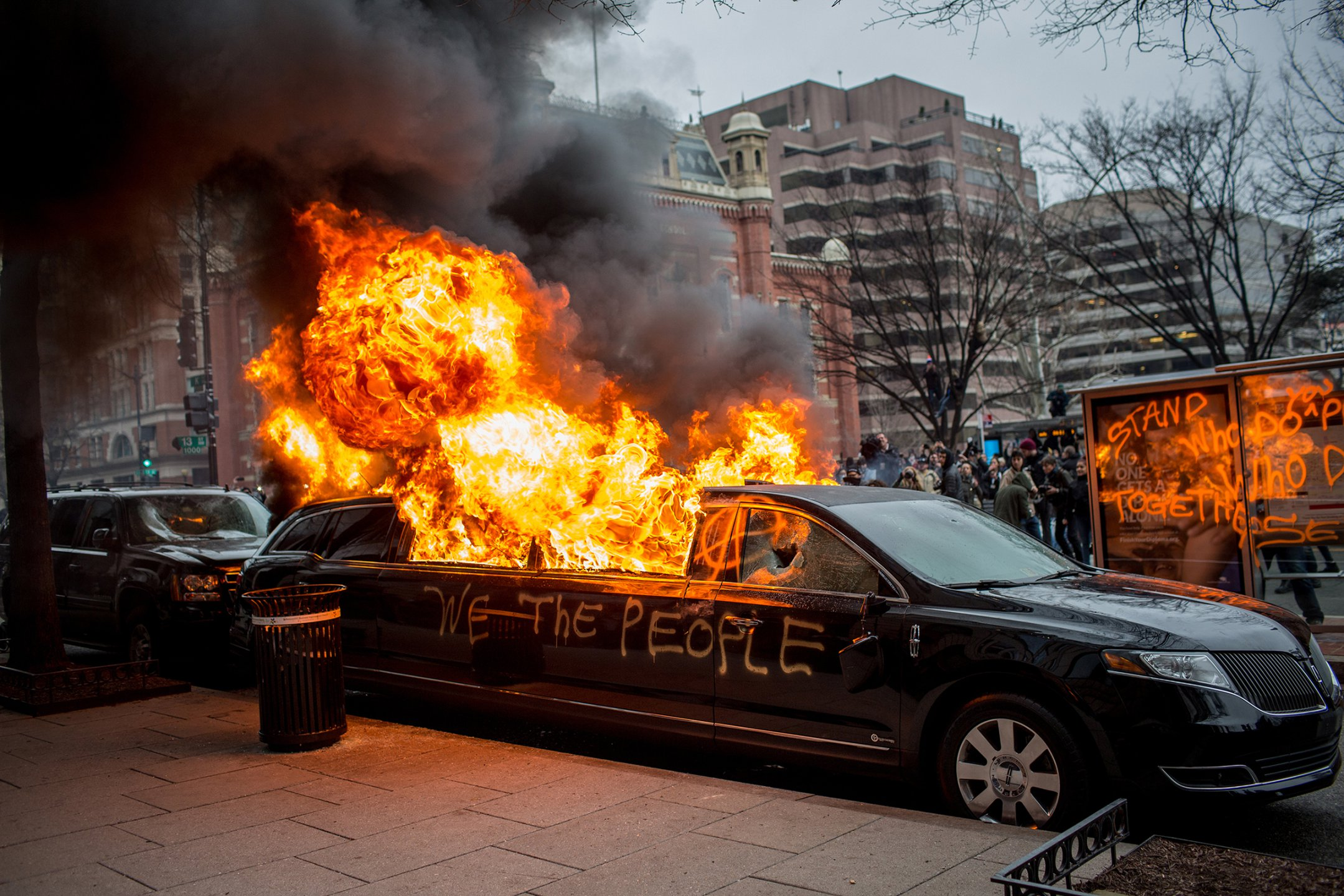 NATALIE KEYSSAR |  www.nataliekeyssar.com  |  @nataliekeyssar   A limousine was set ablaze by a group of protesters against Donald Trump's inauguration near 13th and K Streets in Washington, D.C., on January 20, 2017.  [ TIME ]