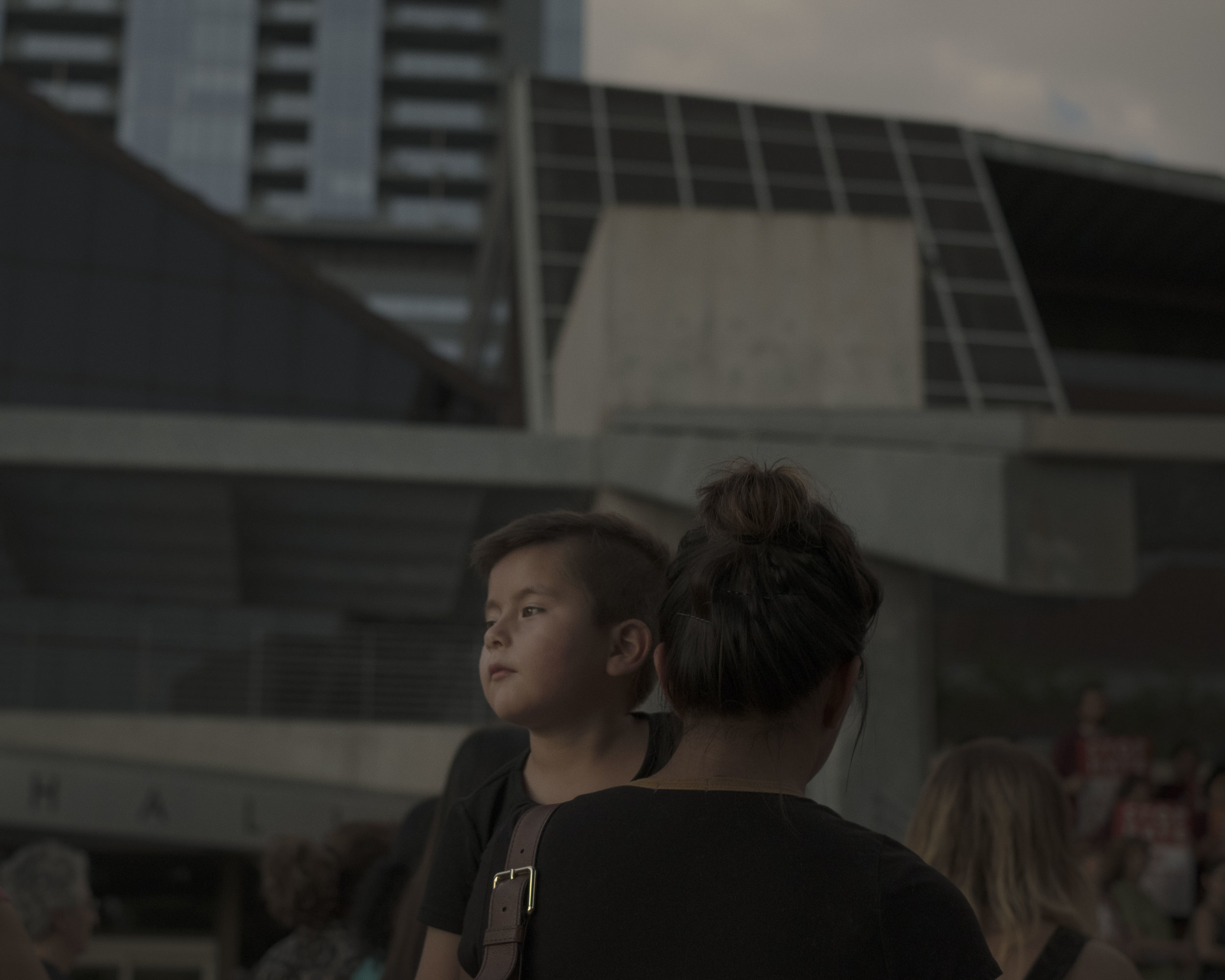 "A boy looks on during a demonstration protesting SB-4 in Austin, Texas on Aug. 31, 2017. Two nights before the September 1st deadline for S.B. 4, Orlando Garcia, a federal District Court judge in San Antonio, temporarily halted implementation of most parts of the bill. He deemed the bill ""unconstitutionally vague"" and blocked the parts requiring jail officials to honor all detainers. Image by Gabriella Demczuk."