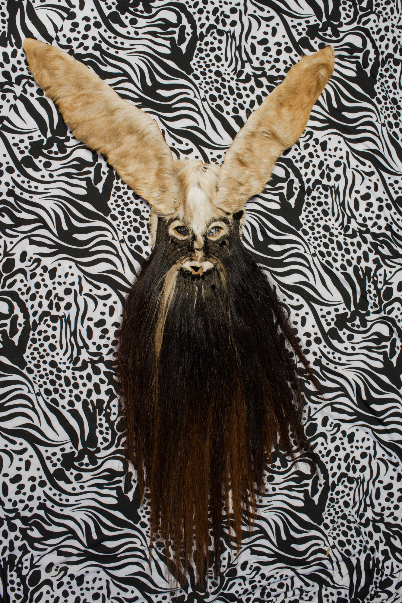Detail of typical mask used during the devil's dance. The masks are usually made with painted cardboard, animal skin, donkey or dog jaws, horsehair manes, and deer horns. They are handmade by local artisans and a mask can cost around 250 USD. Image by Luján Agusti.