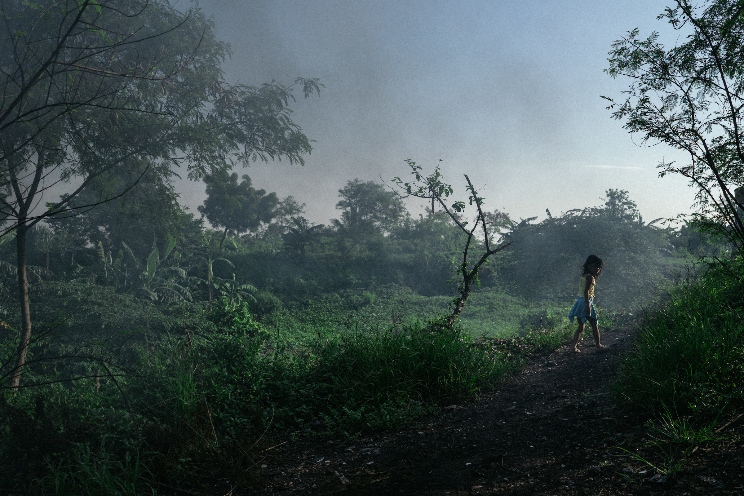 A young girl walks home in Smokey Mountain, Philippines, which used to be Manila's biggest landfill.