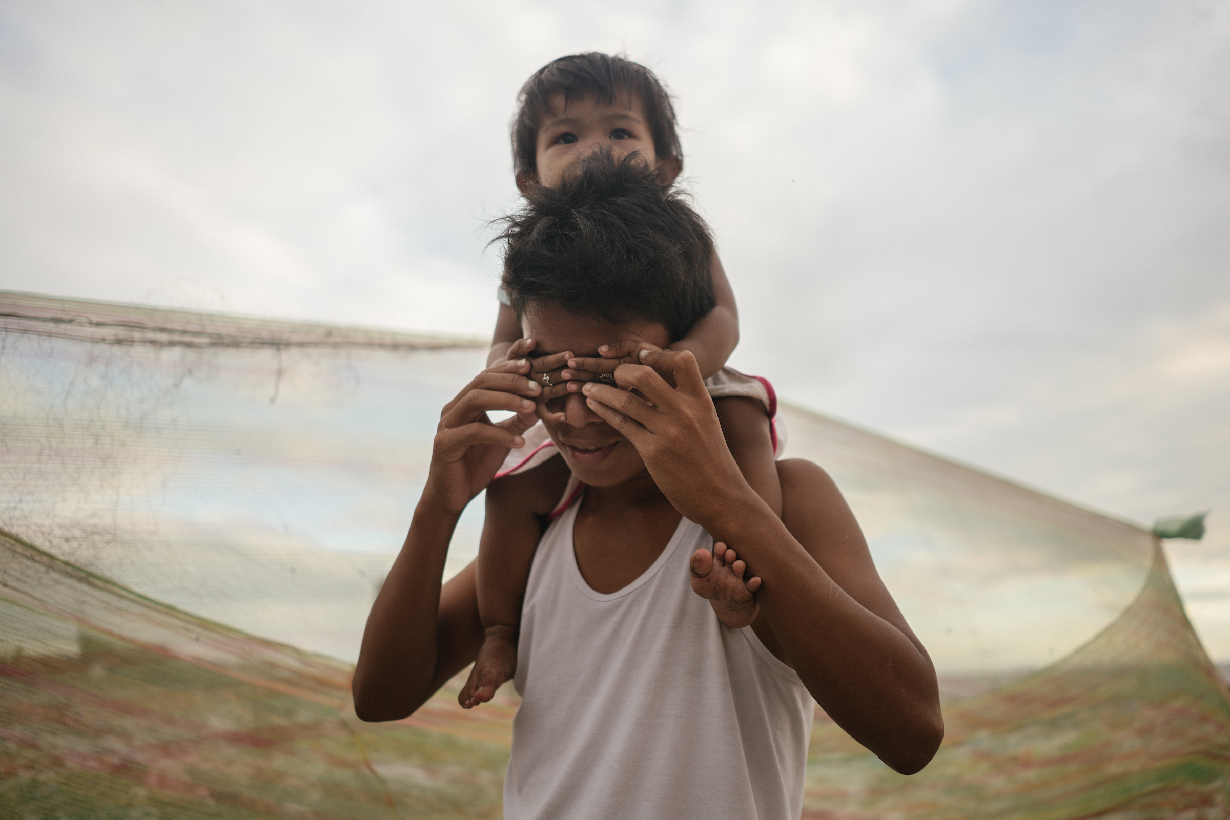 A Filipino man and a child are seen in Tondo, which has one of the highest concentrations of urban poor settlers in Metro Manila, Philippines.