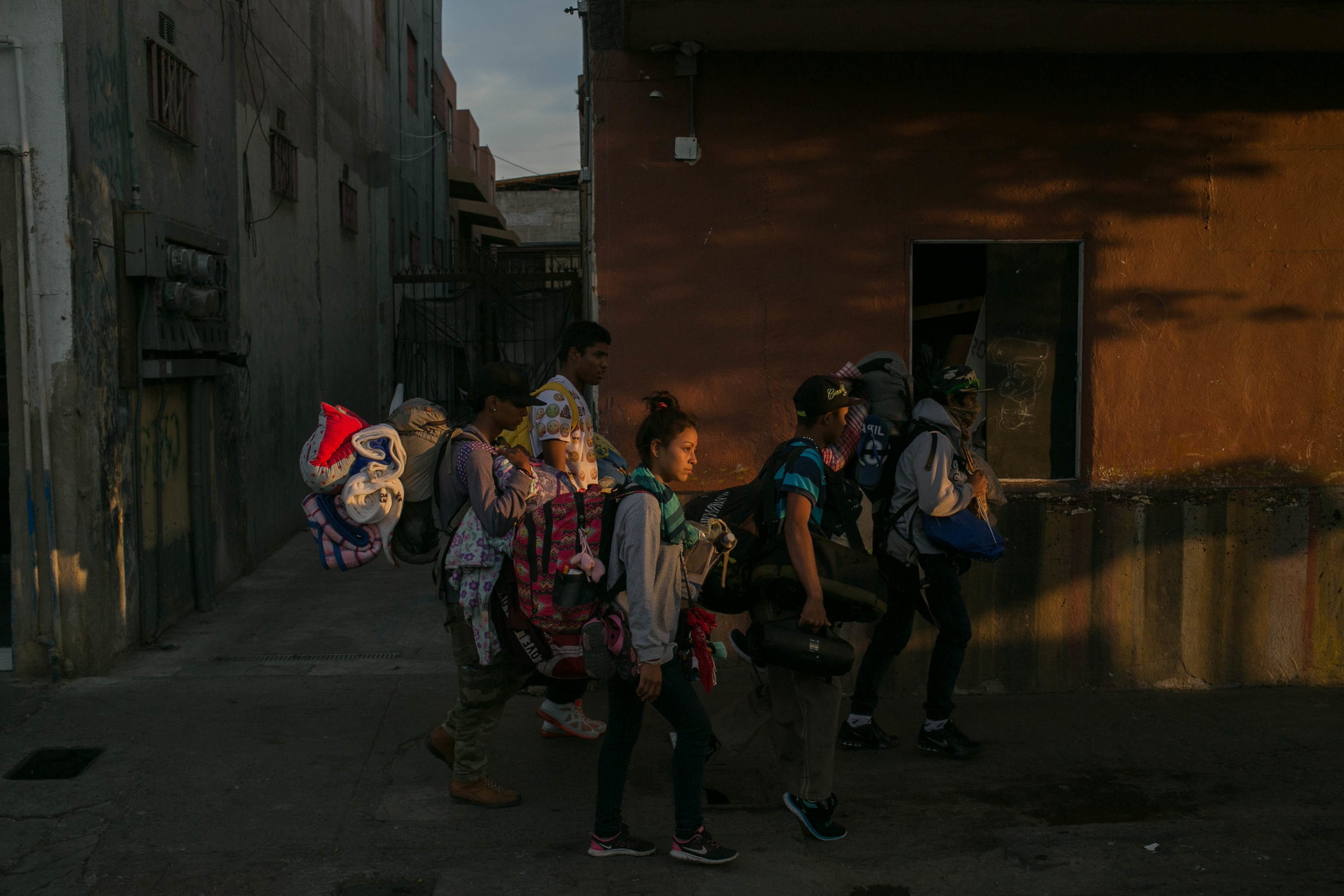 "MEGHAN DHALIWAL  www.meghandhaliwal.com  |  @meghandhaliwal   A group of young Central Americans walk from one shelter to another after the first shelter ran out of room in Tijuana, Baja California Norte, Mexico on April 25, 2018. The group will join about twenty others in sleeping in church pews or on the floor of a shelter in Tijuana's centro. They are on day 31 of their journey to the U.S.-Mexico border, where many plan to apply for asylum. The caravan has drawn international attention after U.S. President Donald Trump's Easter-weekend tweetstorm about the arrival of the migrants on the border. In a statement today, DHS Secretary Kirstjen Nielsen threatened caravan members with prosecution if they ""make a false immigration claim.""  From The New York Times:    After Arduous Journey, Migrants See Stubborn Obstacle: Trump"