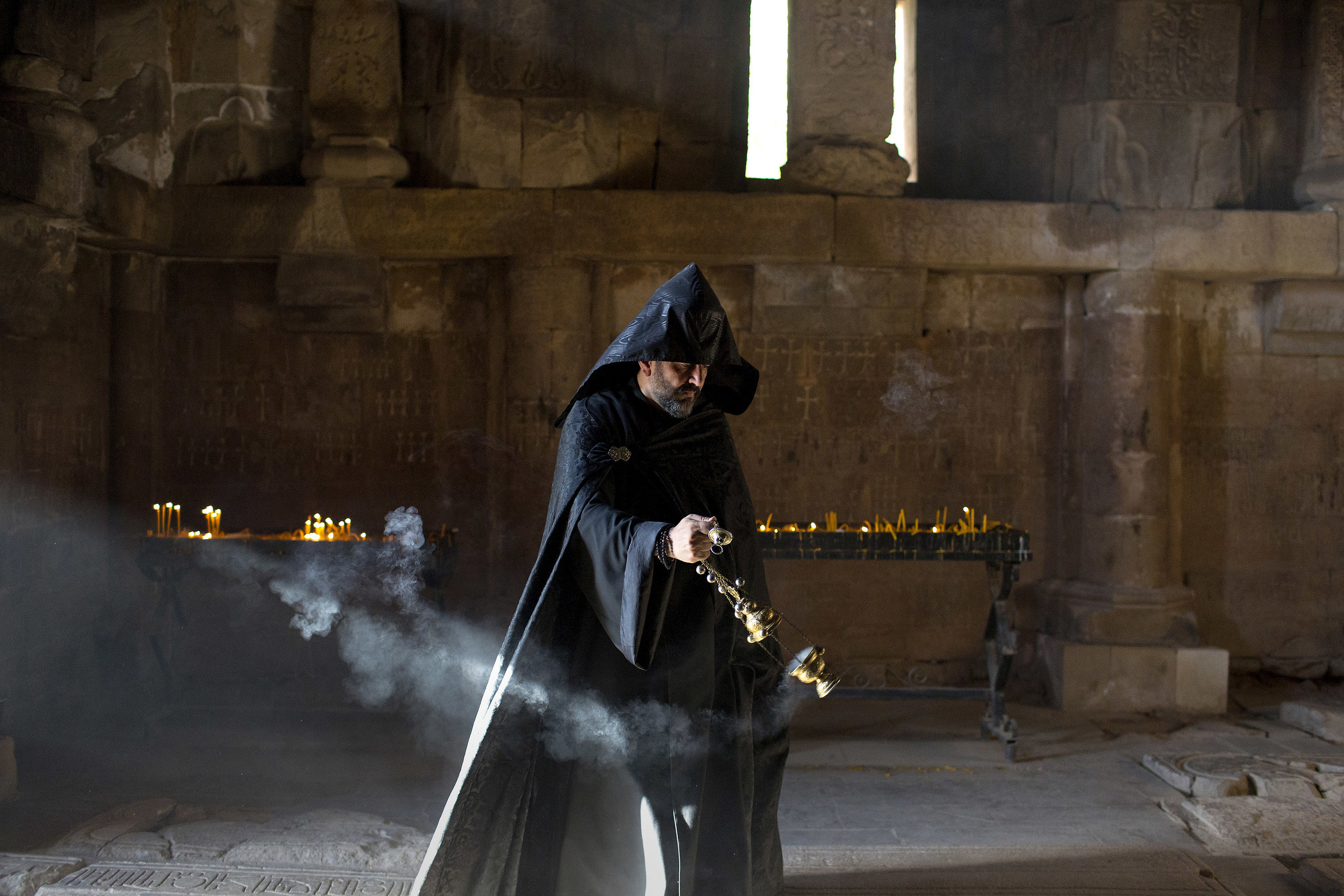 DANIELLE VILLASANA www.daniellevillasana.com |  @davillasana   Father Zareh offers incense in the Surb Karapet Church of the Noravank Monastery complex in Armenia on August 11, 2018.  From The New York Times:    An Ancient Land, Newly Optimistic