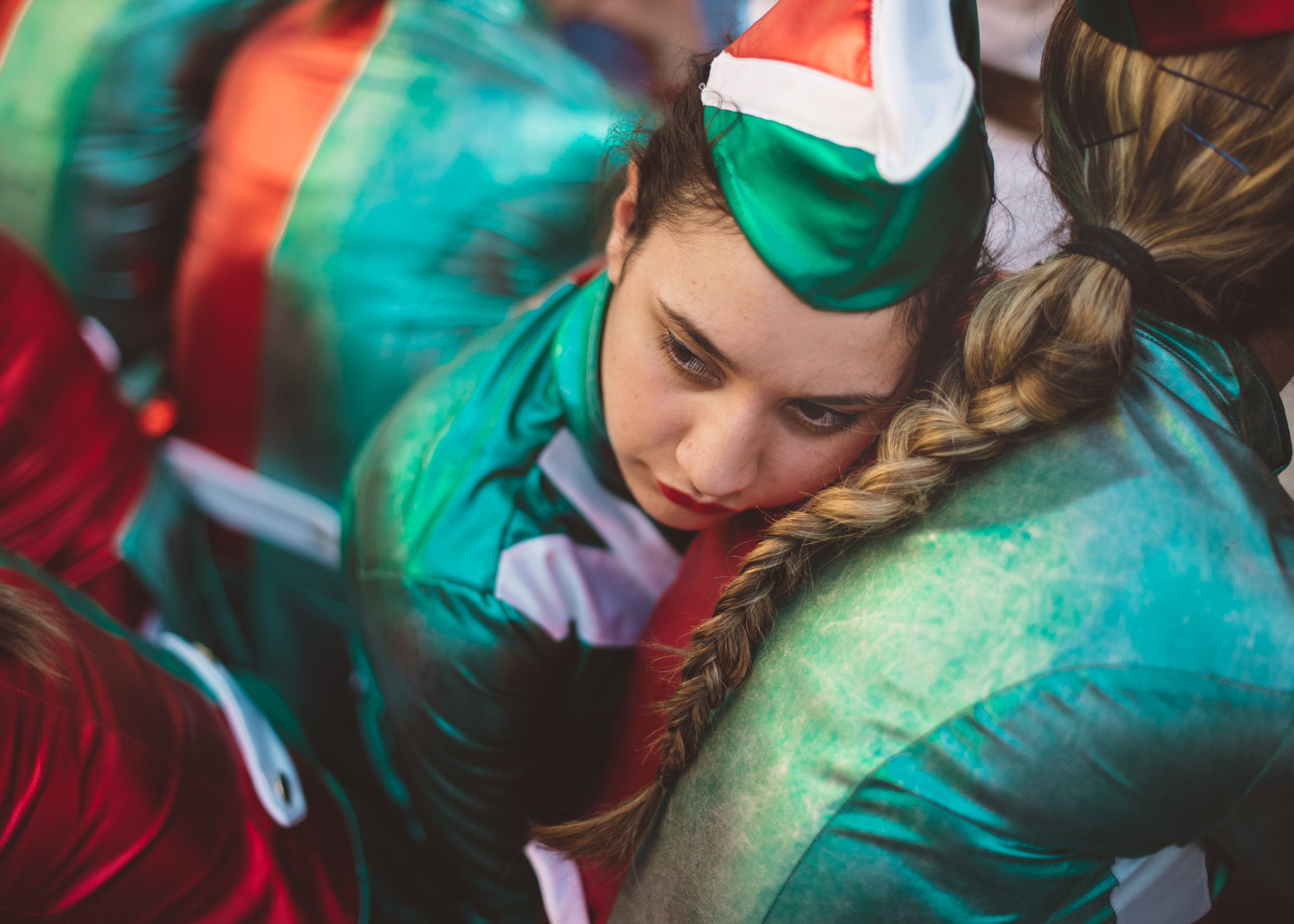 AGNESE MORGANTI  www.aggiemorganti.com  |  @aggiemorganti   Naples, Italy, April 8th 2018. Maria rests her head on the back of her best friend Teresa. Both girls are members of the Sailors Majorettes team from the town of Scafati, Italy. This particular day was very tiresome for the majorettes, as they had been performing non-stop since 6AM in villages around Naples on the occasion of the Madonna dell'Arco, a very popular religious festival. Majorette teams are a beloved Italian tradition, however they have recently become a new way for younger girls to find a platform for belonging and self expression, exploring ideas such as sisterhood, body confidence, discipline and empowerment.