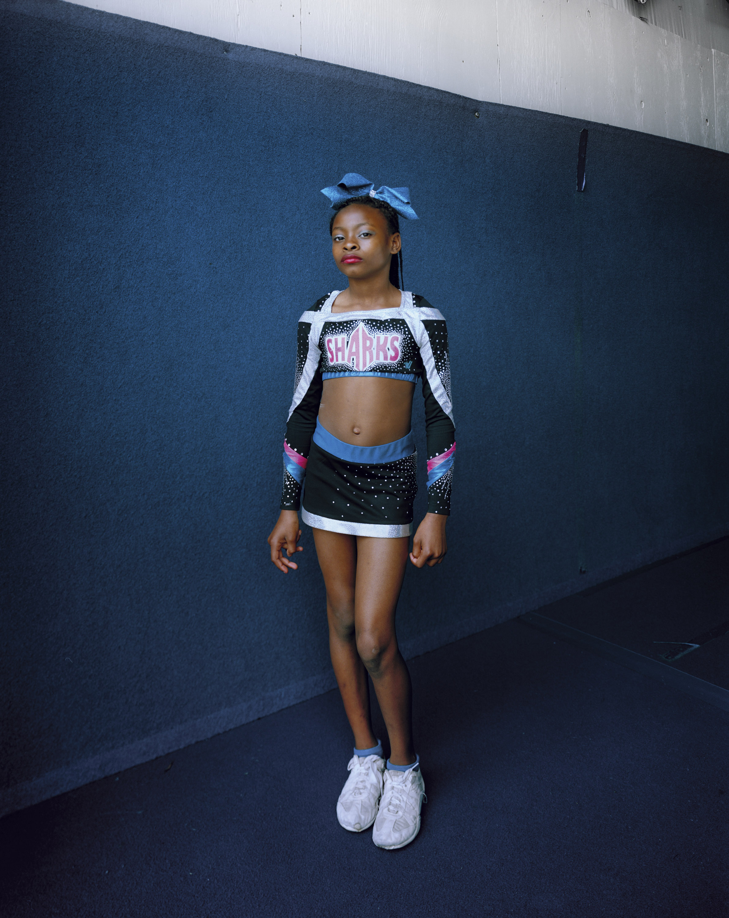 EVA VERBEECK  www.evaverbeeck.com  |  @evaverbeeck   Young cheerleader Jazmine, 11, stands for a portrait after her afternoon cheerleading practice in Savannah, GA, USA.