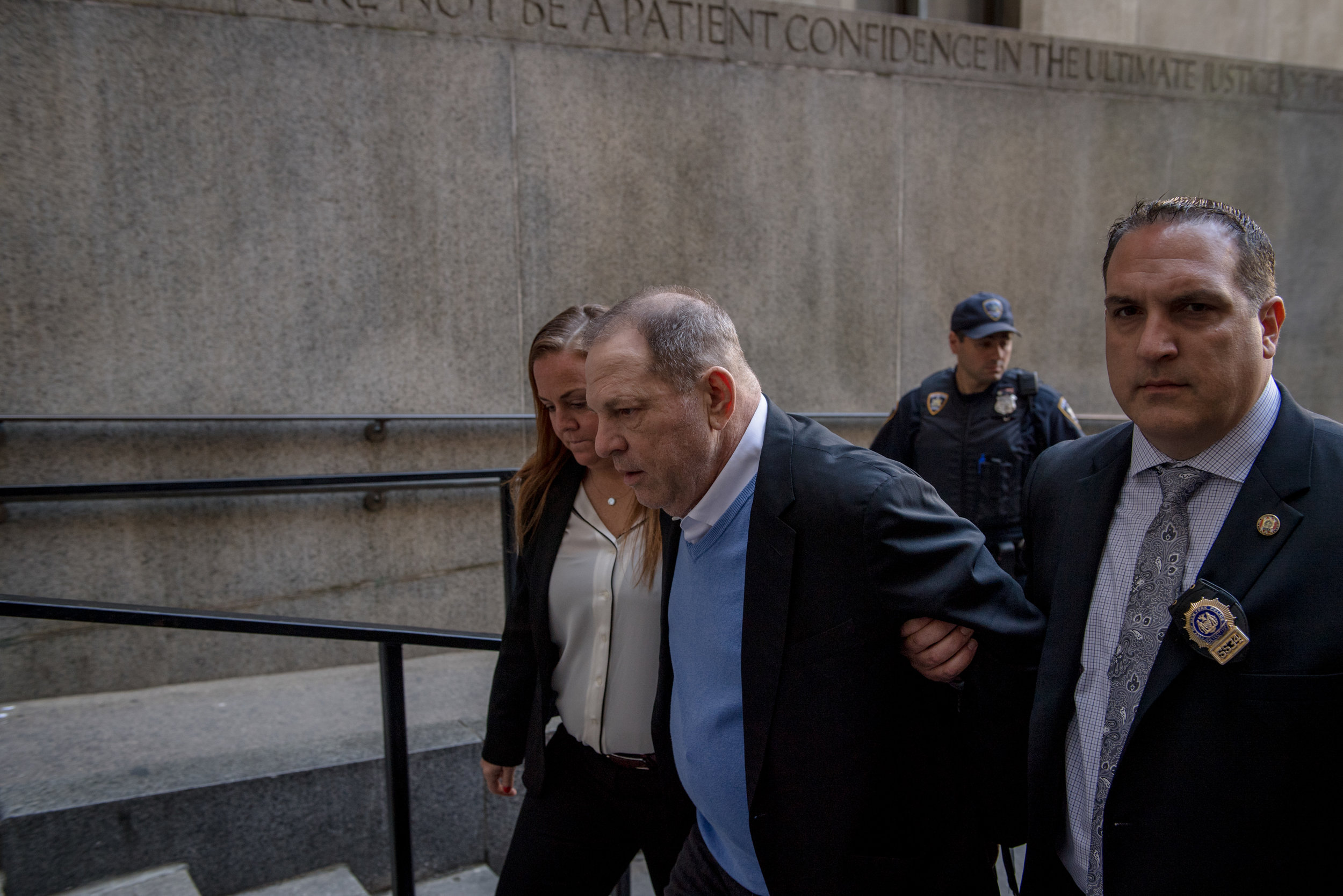 HILARY SWIFT  www.hilaryswift.com  |  @hlswift   Harvey Weinstein is escorted into Manhattan Criminal Court for the first time on May 25, 2018. Weinstein, formerly a powerful Hollywood producer, has been accused of sexual abuse by more than 80 women, and was one of the first men toppled by the #MeToo movement.  From The New York Times:    Weinstein in Handcuffs Is a 'Start to Justice' for His Accusers