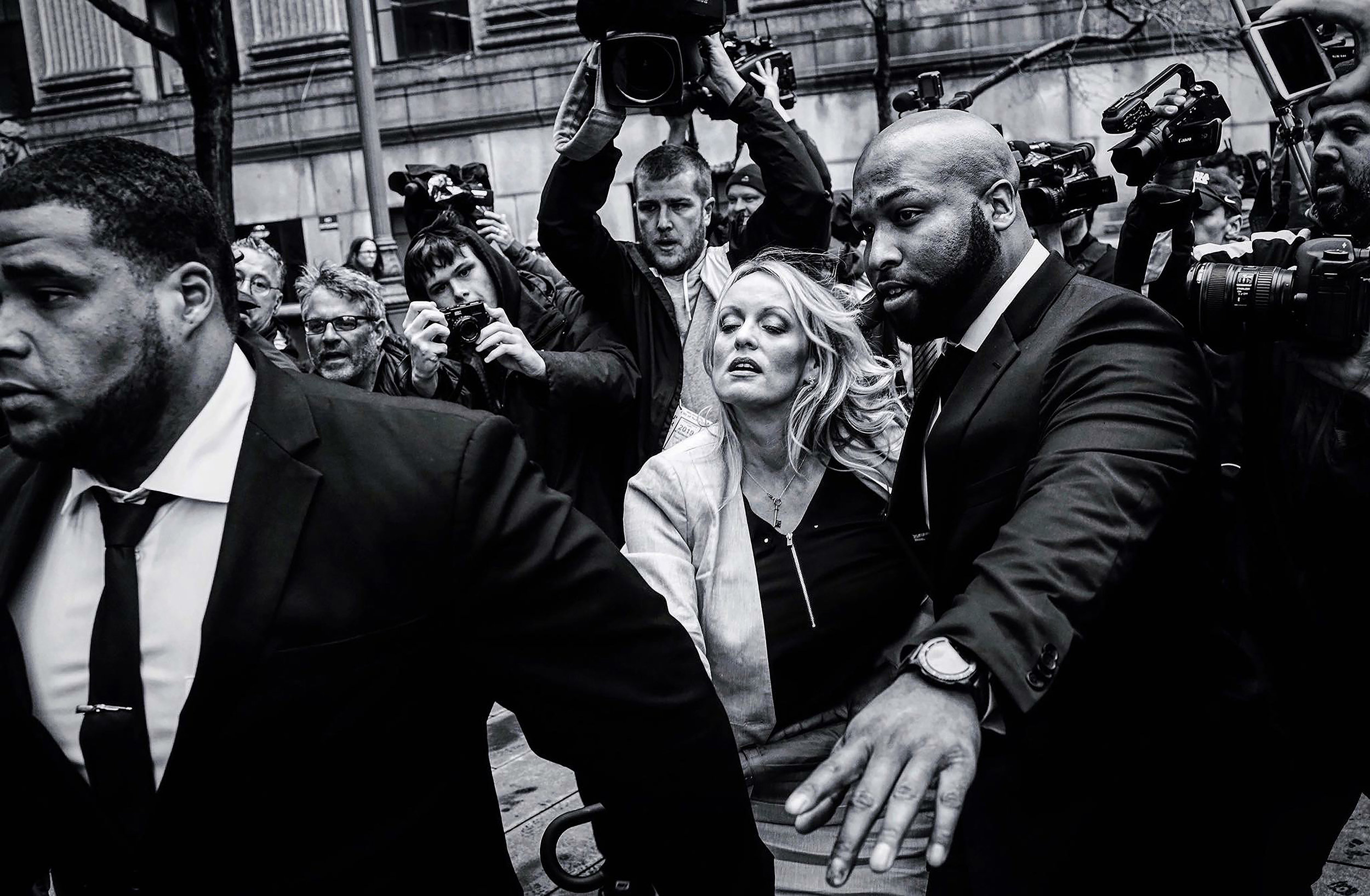YANA PASKOVA  www.yanapaskova.com  |  @yanapaskova   Adult film actress Stormy Daniels (Stephanie Clifford) arrives to Federal Court with her lawyer Michael Avenatti (not seen) at the United States District Court Southern District of New York after a hearing related to Michael Cohen, President Trump's longtime personal attorney and confidante, on April 16, 2018 in New York City. Cohen and lawyers representing President Trump are asking the court to block Justice Department officials from reading documents and materials related to his Cohen's relationship with President Trump that they believe should be protected by attorney-client privilege. Officials with the FBI, armed with a search warrant, raided Cohen's office and two private residences last week.