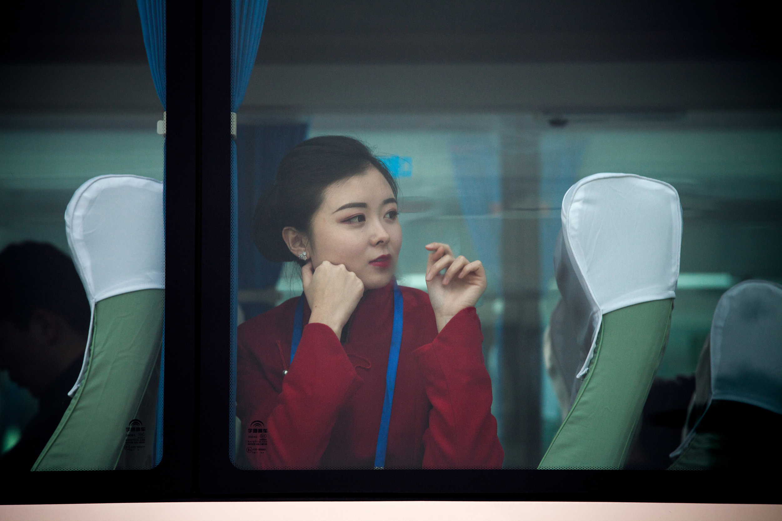 GIULIA MARCHI  www.giuliamarchi.com  |  @giuliamarchiphoto   An attendant for the 13th National People's Congress (NPC) looks out from a coach parked in front of the Great Hall of the People in Beijing, China, on Wednesday, March 7, 2018. President Xi Jinping is preparing to extend a sweeping government overhaul that would give the Communist Party greater control over everything from financial services to manufacturing to entertainment.  From Bloomberg News:    China's Biggest Political Gathering Could Let Xi Rule for a Lifetime   .