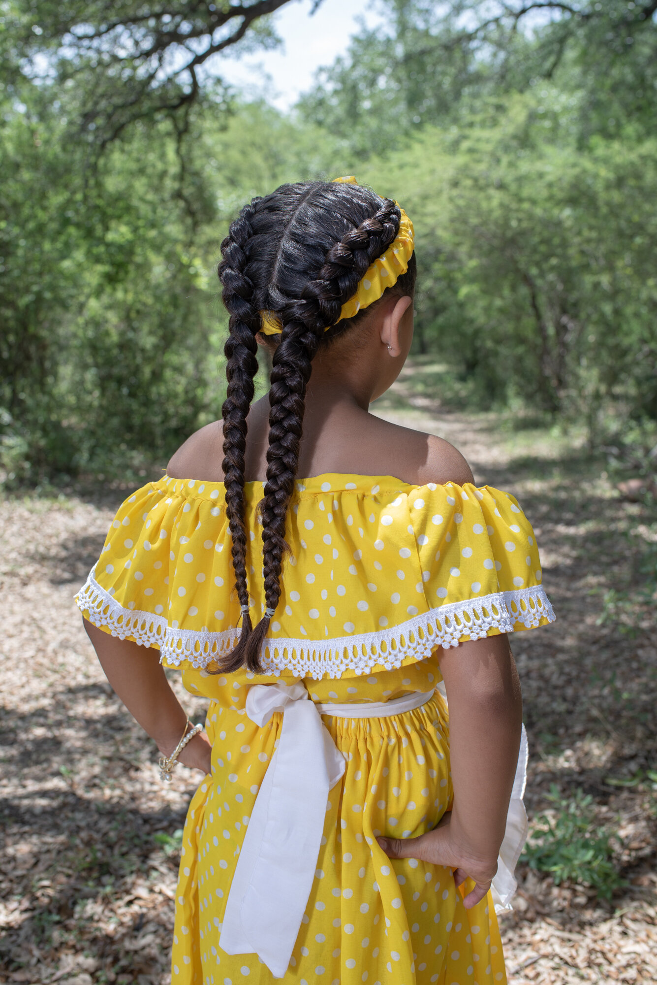Maria, 6 years old, poses for a portrait wearing the typical Mascogos outfit, during Juneteenth celebrations. Juneteenth commemorates the June 19, 1865, announcement of the abolition of slavery in Texas.