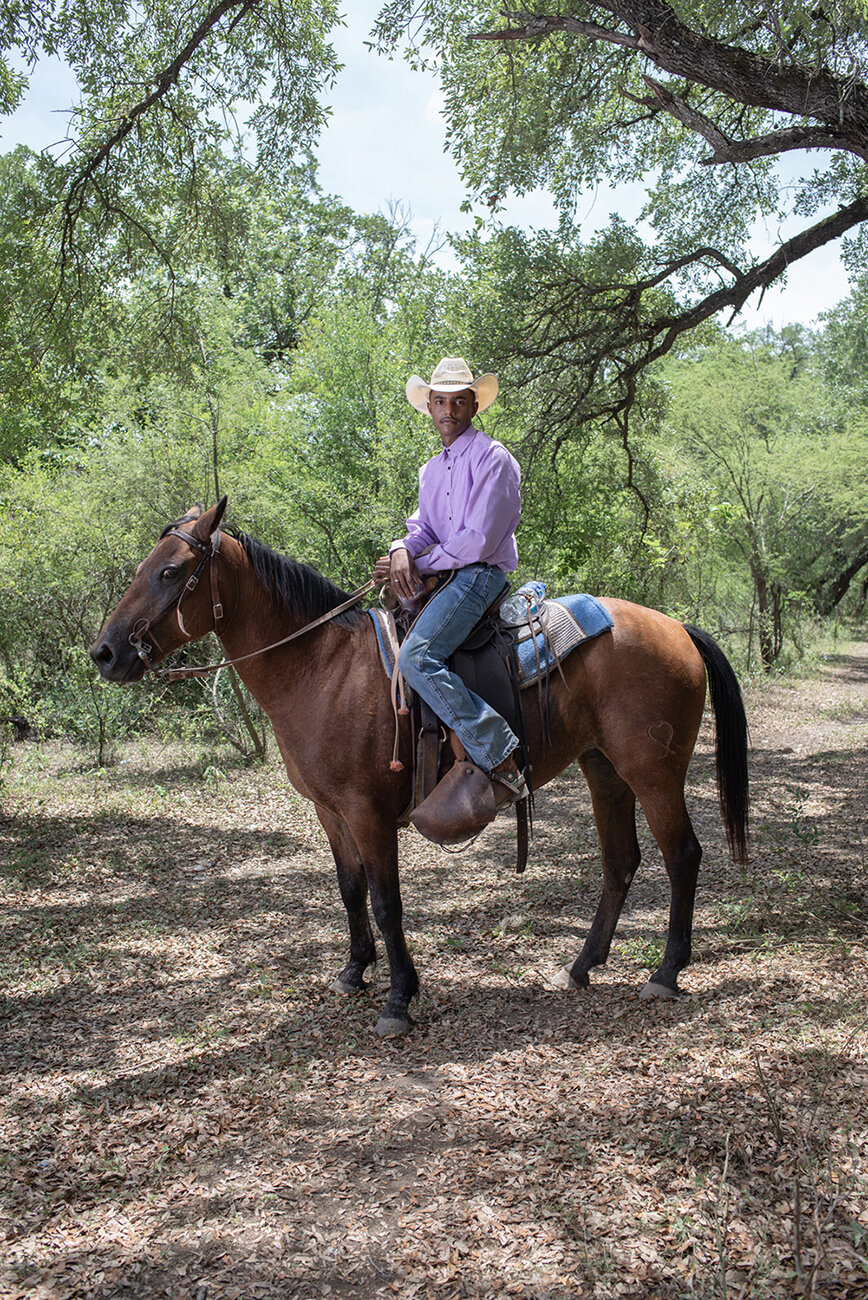 Adan Salazar, 15 years old, poses for a portrait with his horse, during Juneteenth celebrations. Adan belongs to the Mascogos, an afrodescendant community located in Coahuila, Mexico.