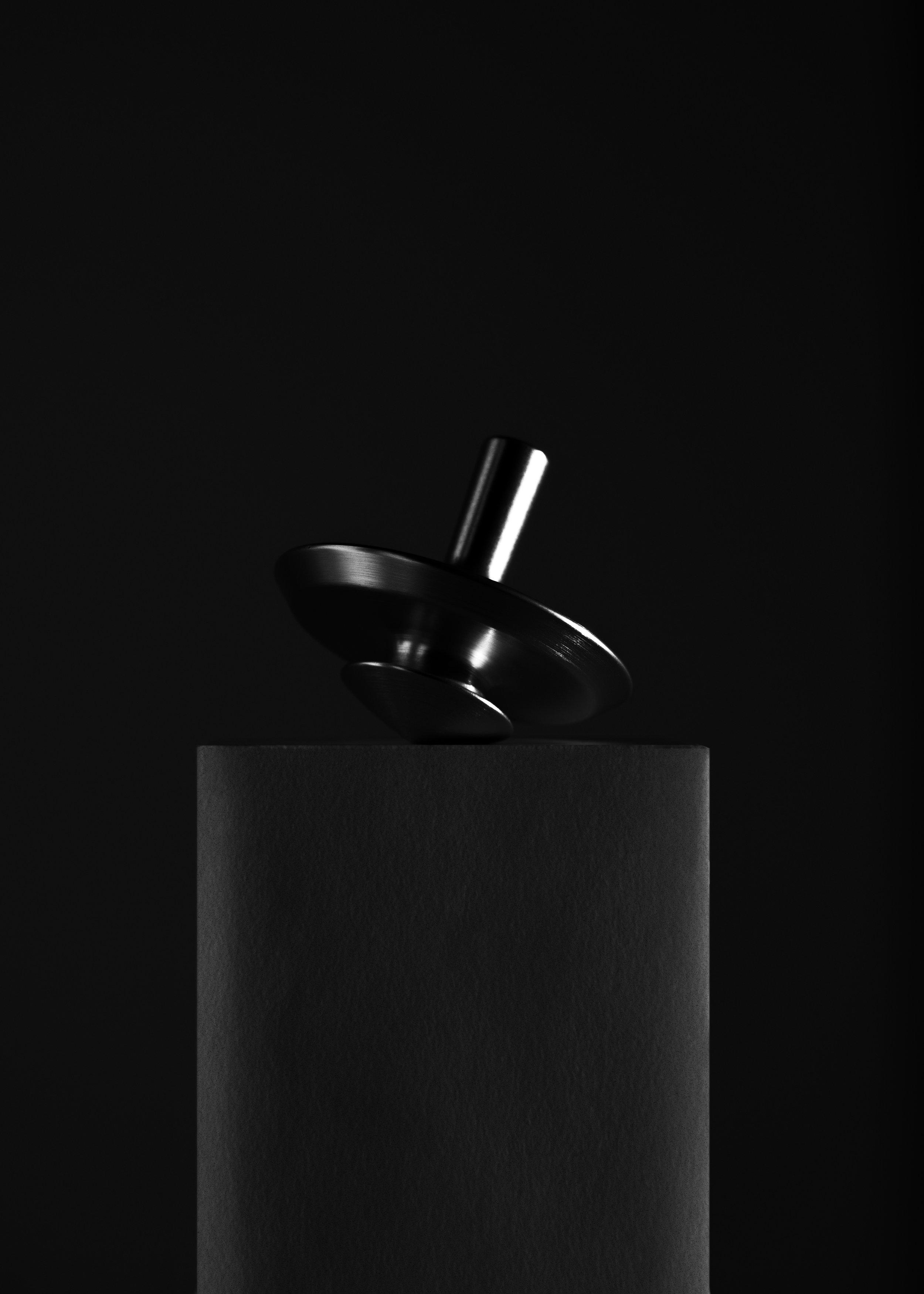 spin-bottle-opener-pedestal-nicholas-baker
