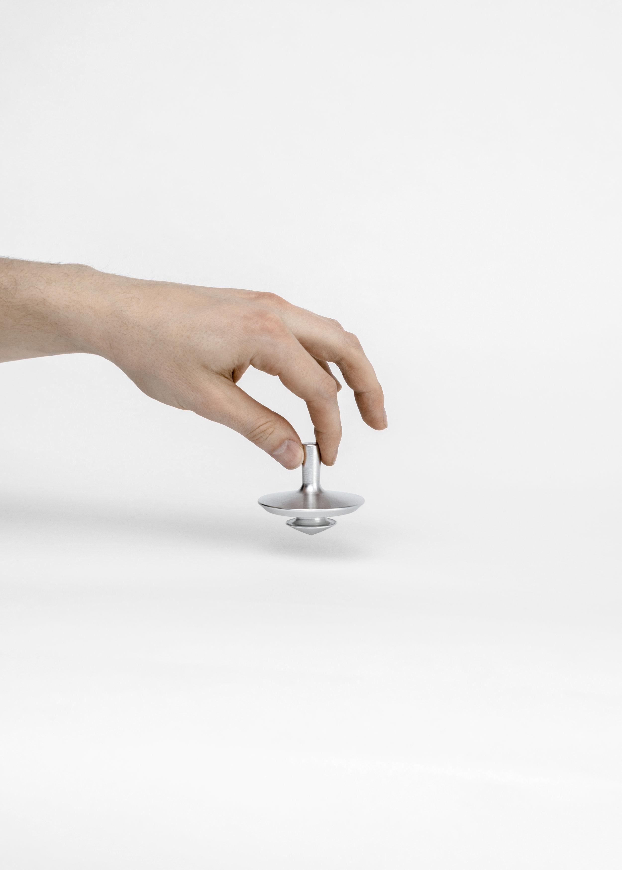 spin-bottle-opener-hand-nicholas-baker