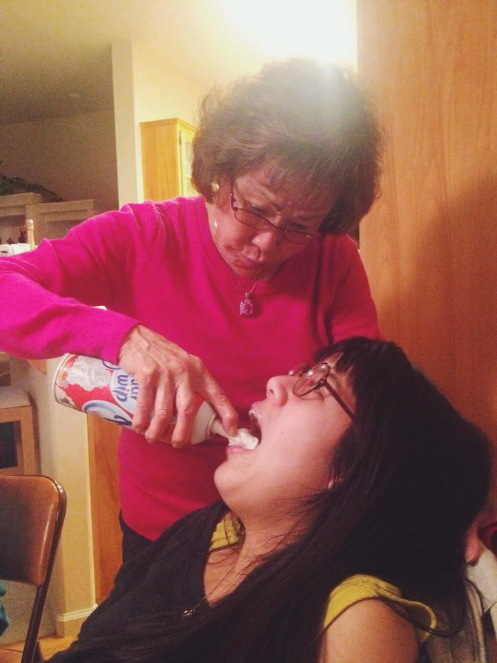 this is my grandmother spraying whipped cream into my cousin's mouth. we're just that classy.