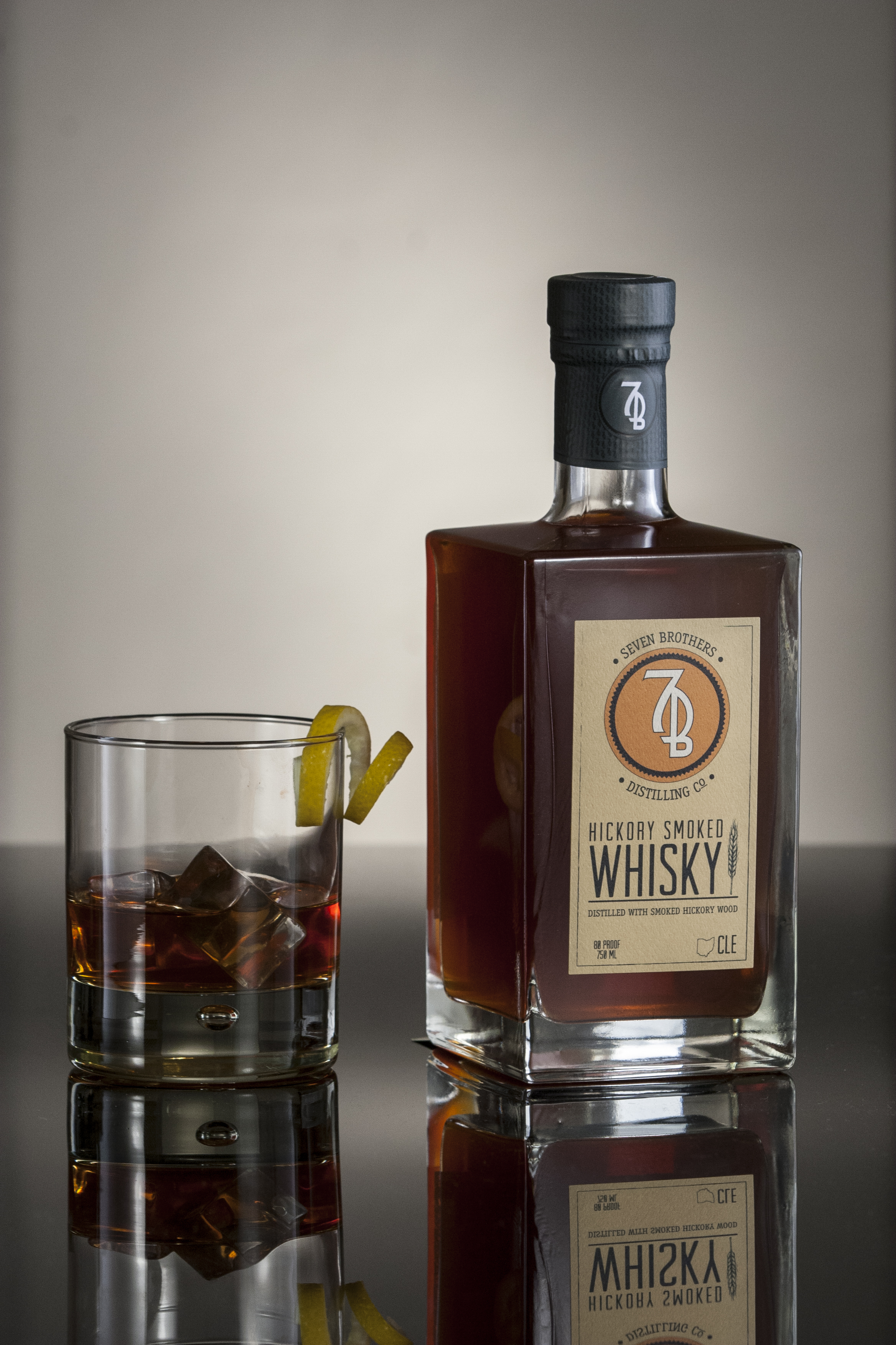 SMOKED OLD FASHIONED - 2 oz Seven Brothers Hickory Smoked Whisky1/4 oz simple syrup2-3 dash Angostura Bitters2-3 dash Orange BittersStir with ice and strain over one large cube into a Rocks glass. Garnish with a lemon twist.