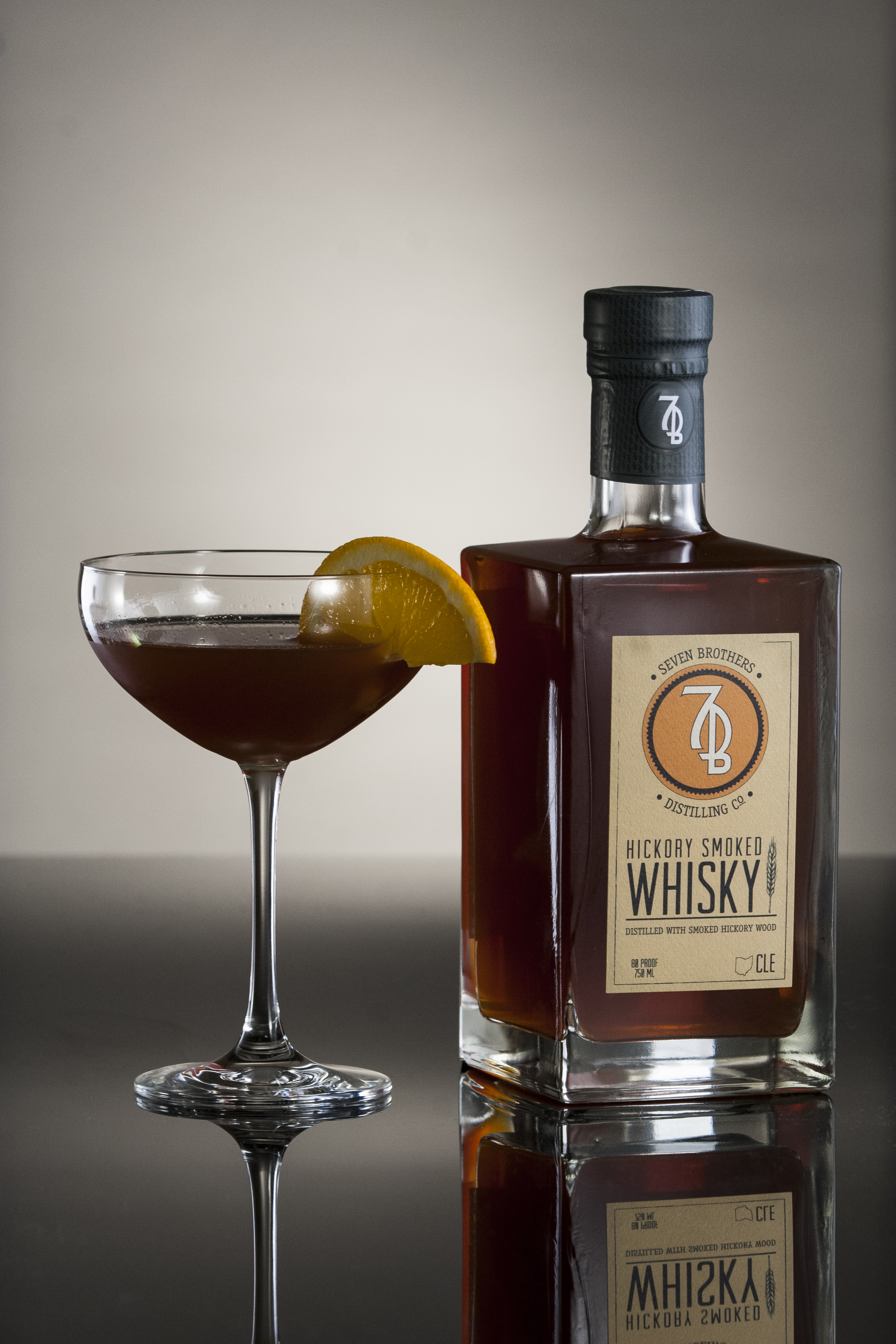 SMOKY GROVE - 2 oz Seven Brothers Hickory Smoked Whisky1/2 oz Sweet Vermouth (Carpano Antica)1/2 oz Dry Vermouth (Dolin)1 dash Angostura Bitters1 dash Orange BittersStir with ice and strain into a chilled Coupe. Garnish with a cherry or orange.
