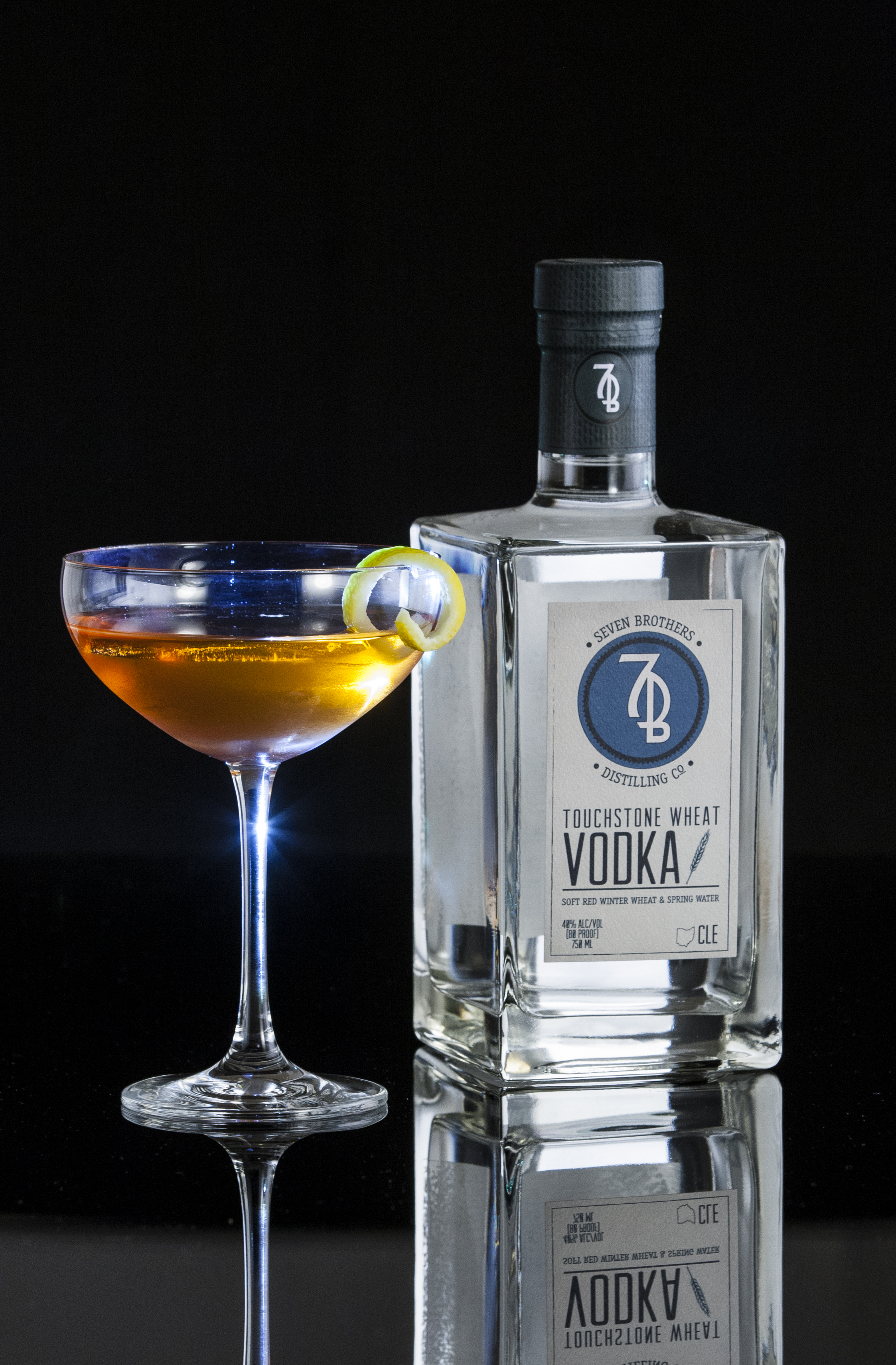 THE QUEEN B - 2 oz Seven Brothers Touchstone Wheat Vodka1 oz Benedictine or Yellow Charteuse2 dashes Angostura BittersCombine all ingredient in a mixing glass and stir over ice. Strain into a chilled Coupe and garnish with a lemon twist