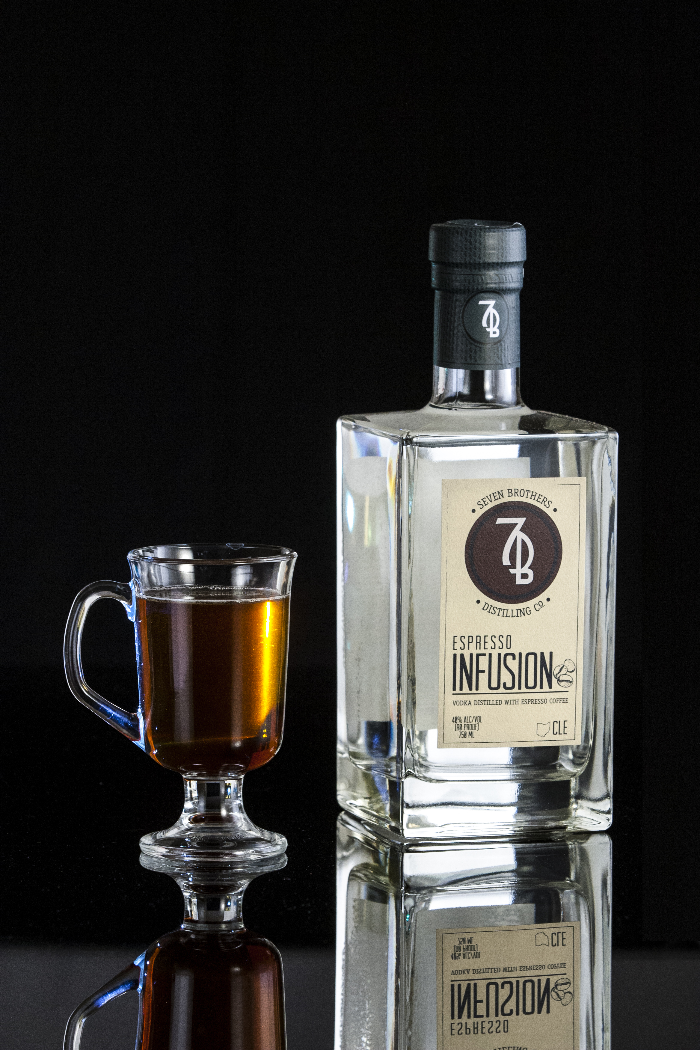 7B BLACK & WHITE - 1.25 oz Seven Brothers Espresso Infusion.5 oz Simple Syrup.25 oz Vanilla Extract (Maple Syrup)3 dash Chocolate BittersGuinnessCombine ingredients and stir briefly in a Coffee glass. Top with Guinness.