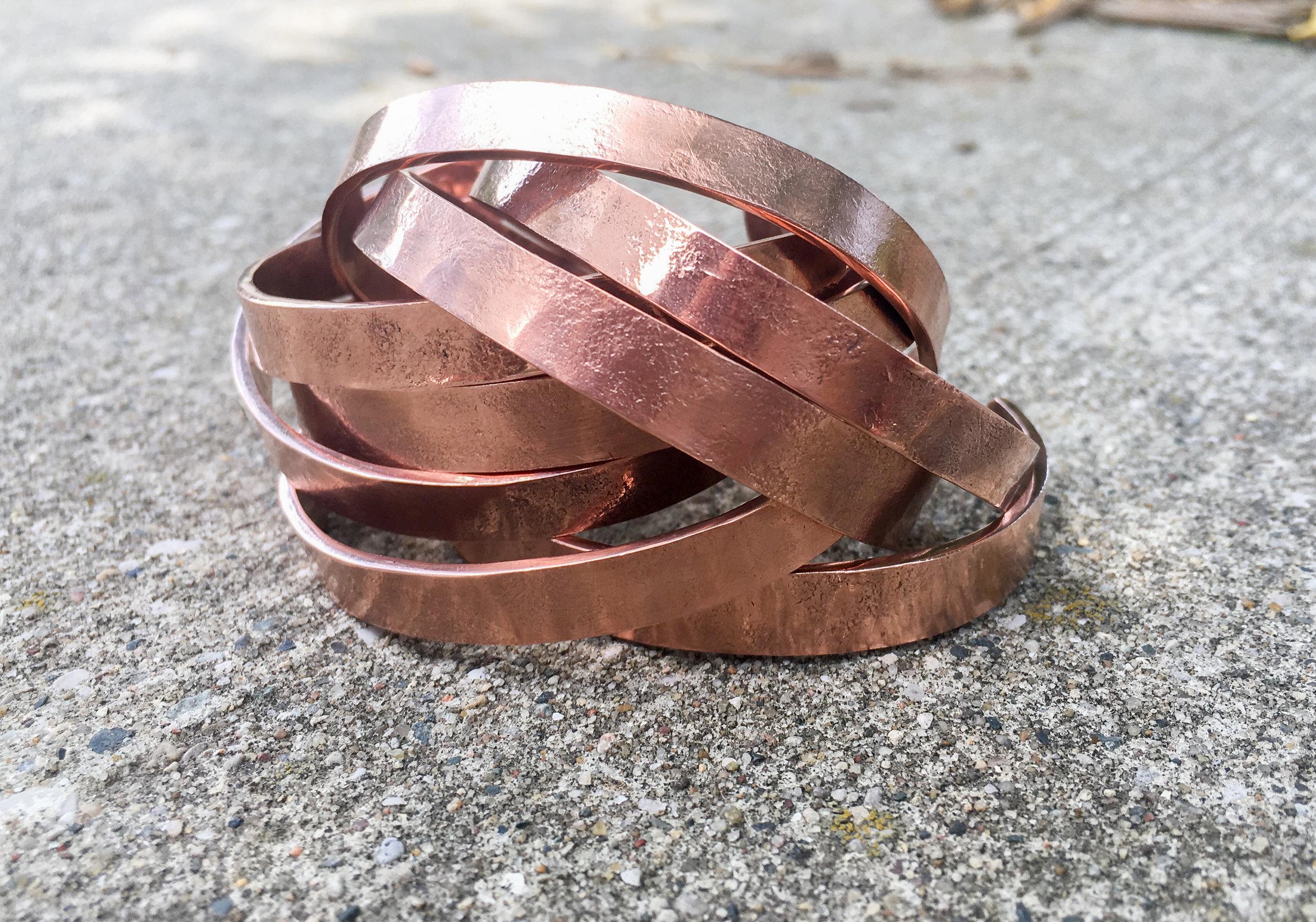 Hand cut and hammered bangle bracelets