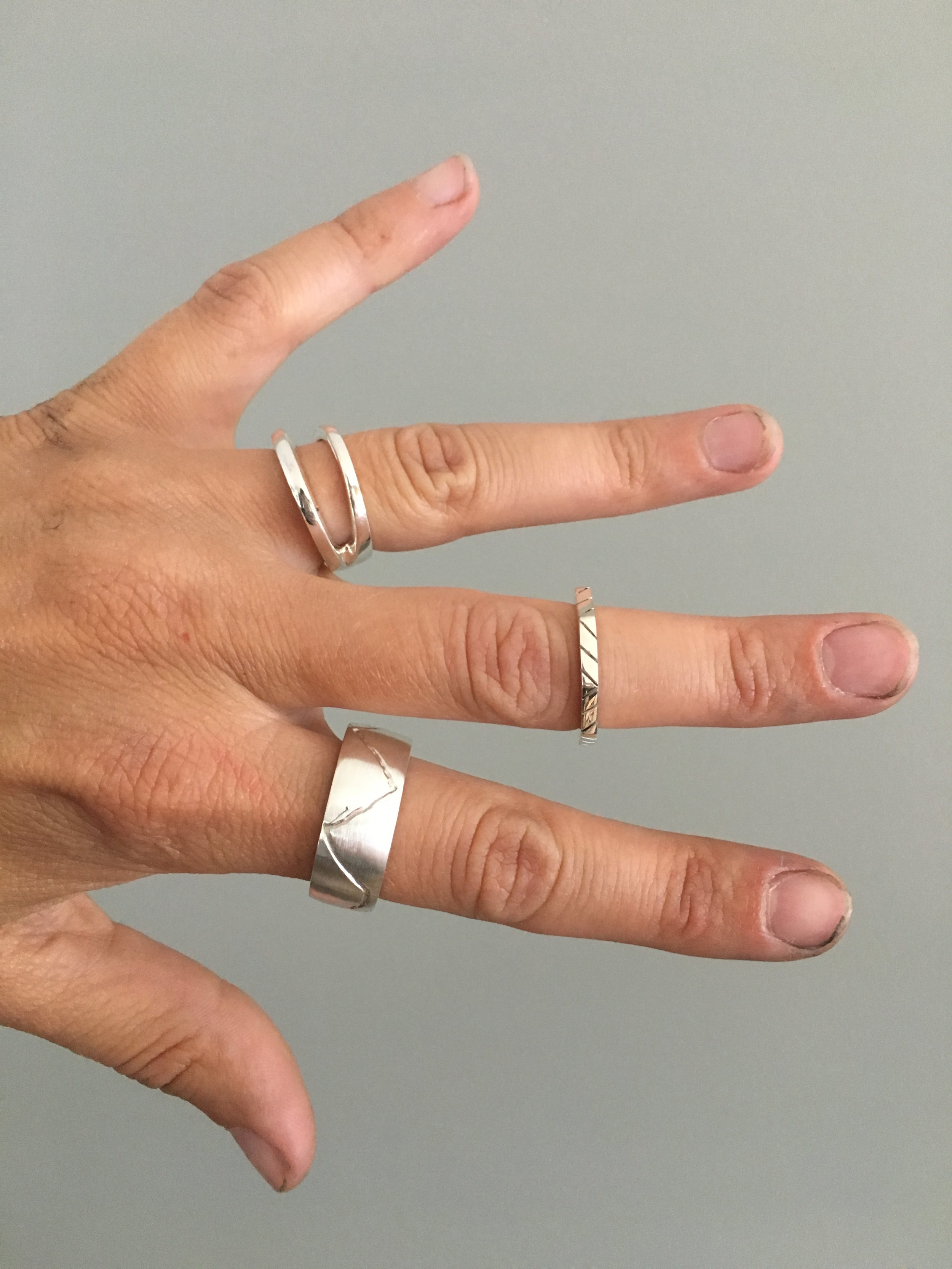 The final product of 3 custom sterling silver rings.