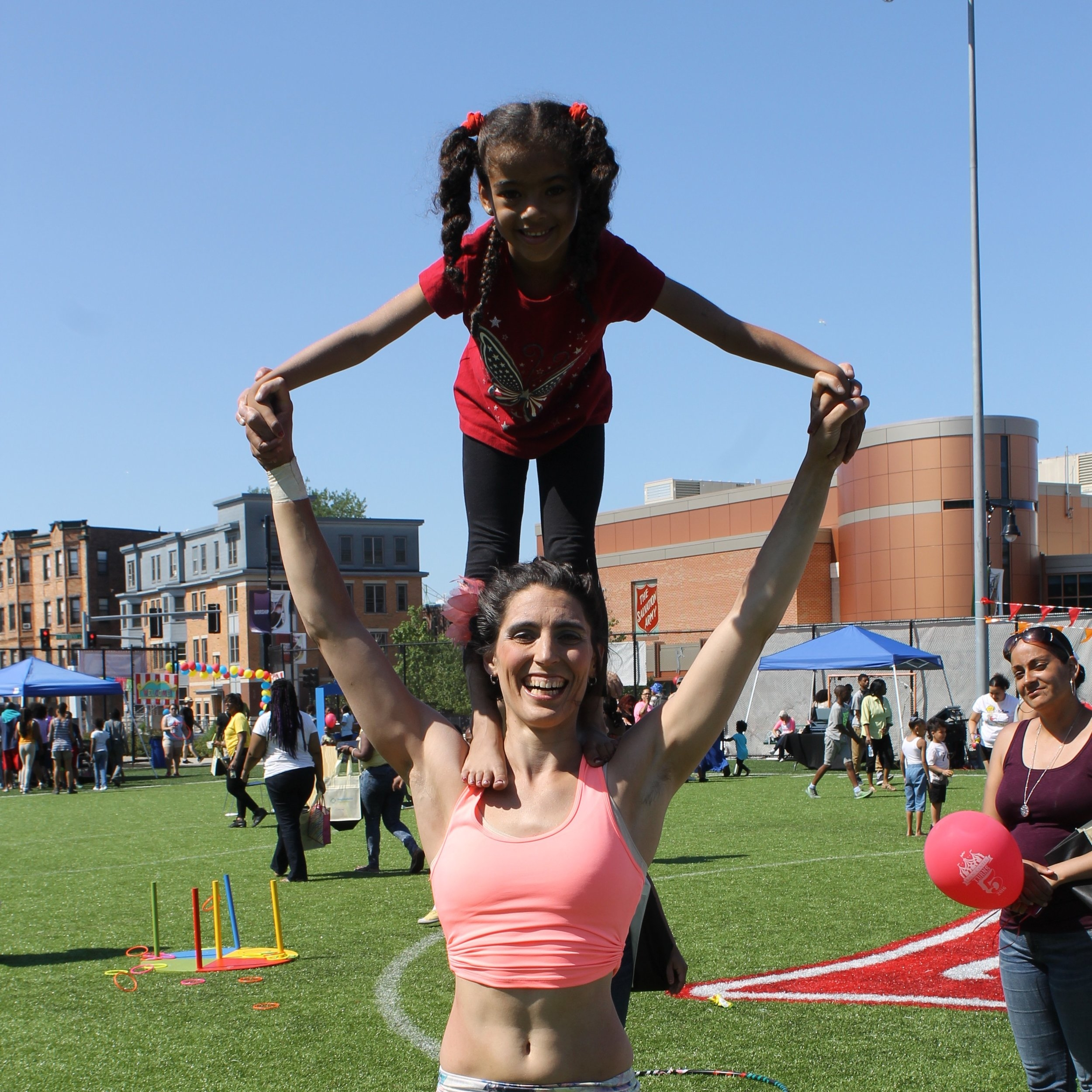 Circus Up Founder and Executive Director Leah Abel doing partner acrobatics at the Kroc in Dorchester.