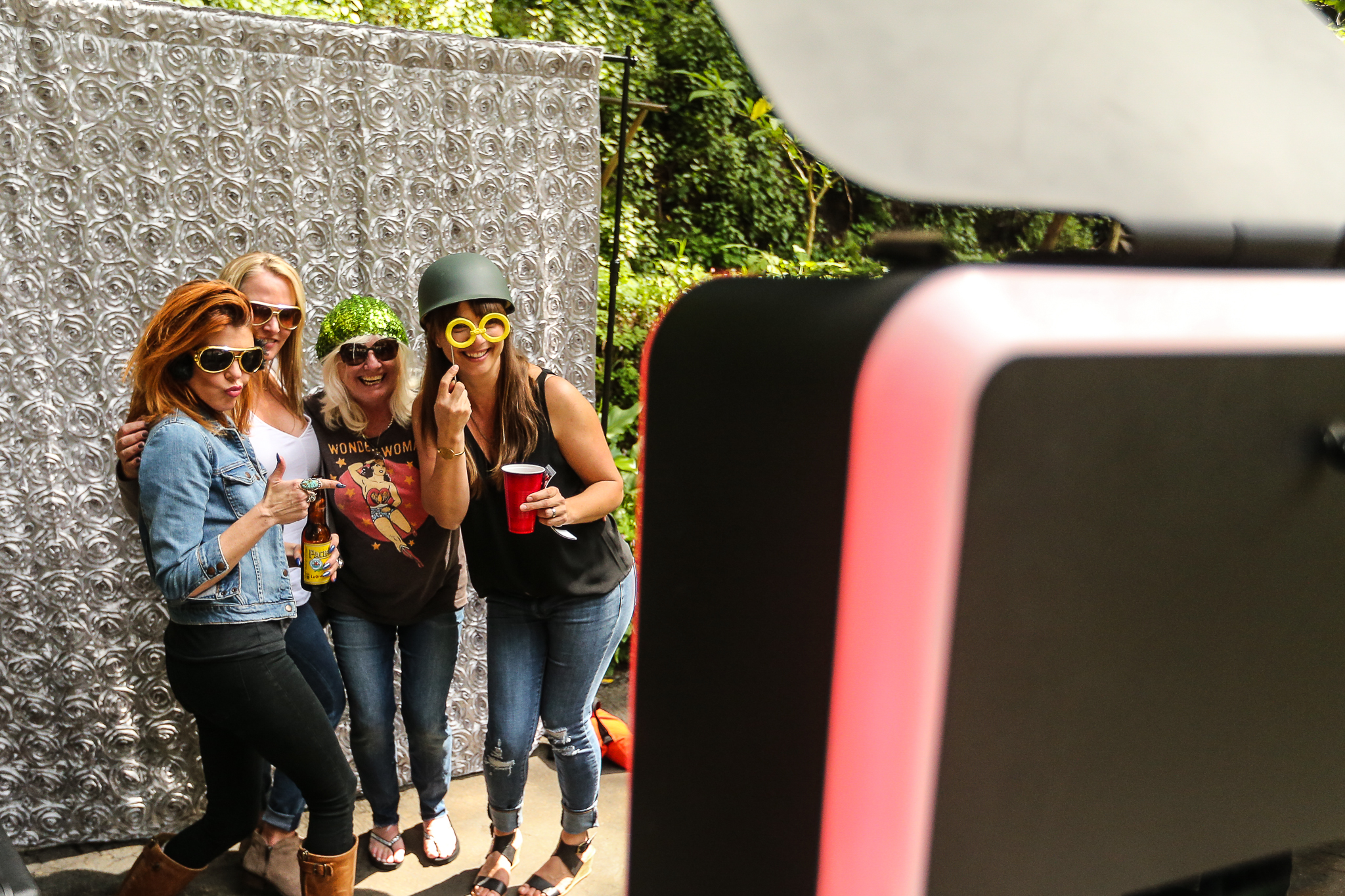Guests using our Infinite photobooth outside. This is one of the things I love most about open-air photobooths like this. They can be set up in pretty much any location, including outside!