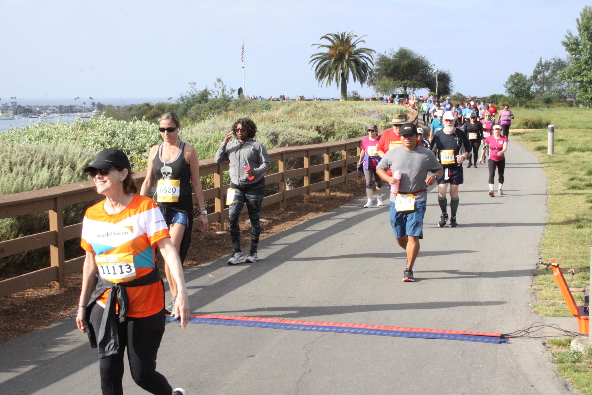 Rahbin Shyne (3rd from left) walking in the OC Half-Marathon